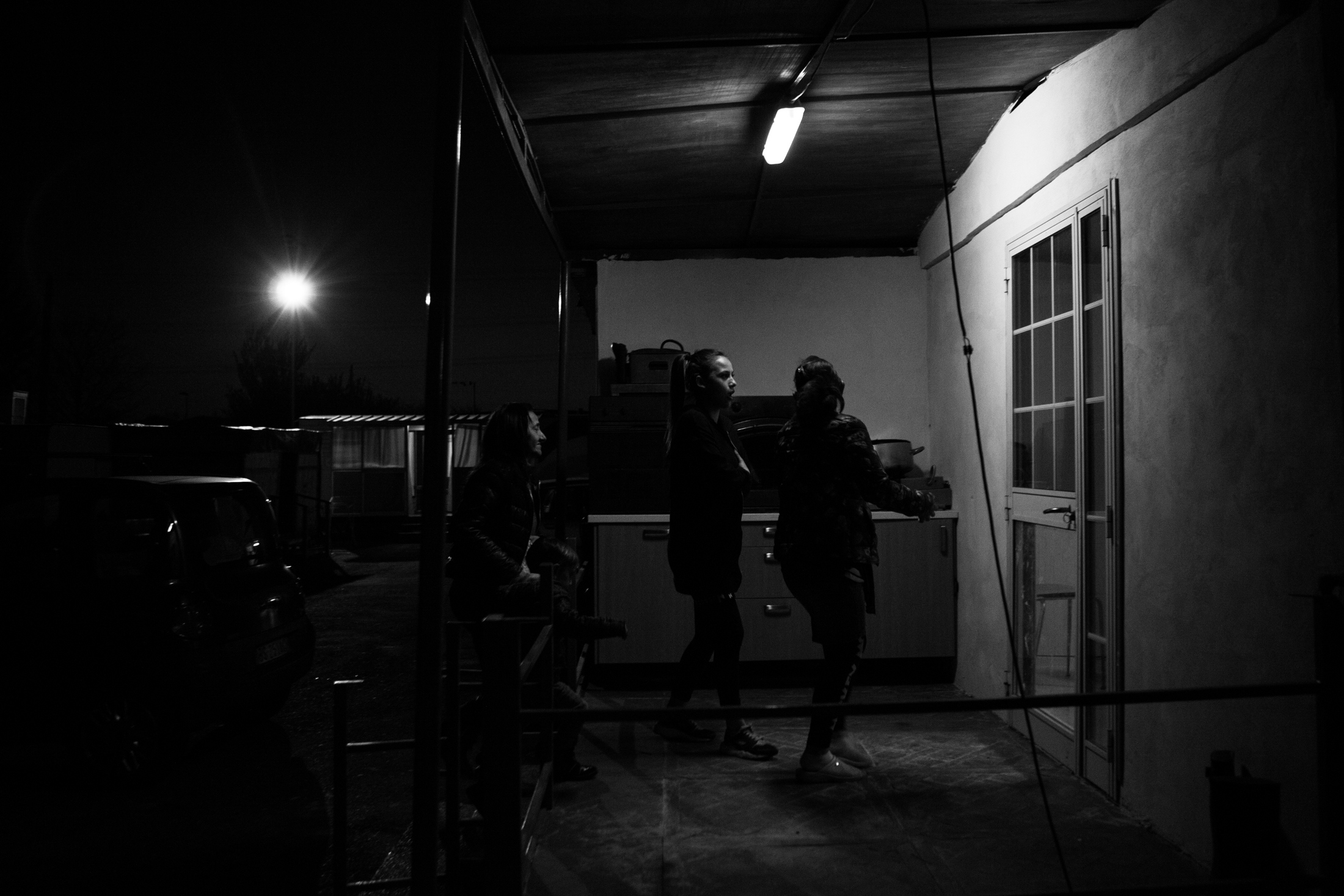 March 2017, nomad camp of Castelnuovo Rangone, Emilia Romagna, Italy. Linda, her daughter and sister are about to enter the mobile home where evangelical worship takes place. Evangelical cults are gaining ground within the Sinti community. The shepherds, also of the Sinti ethnic group, move from field to field to support the various cults and involve an increasing number of faithful.