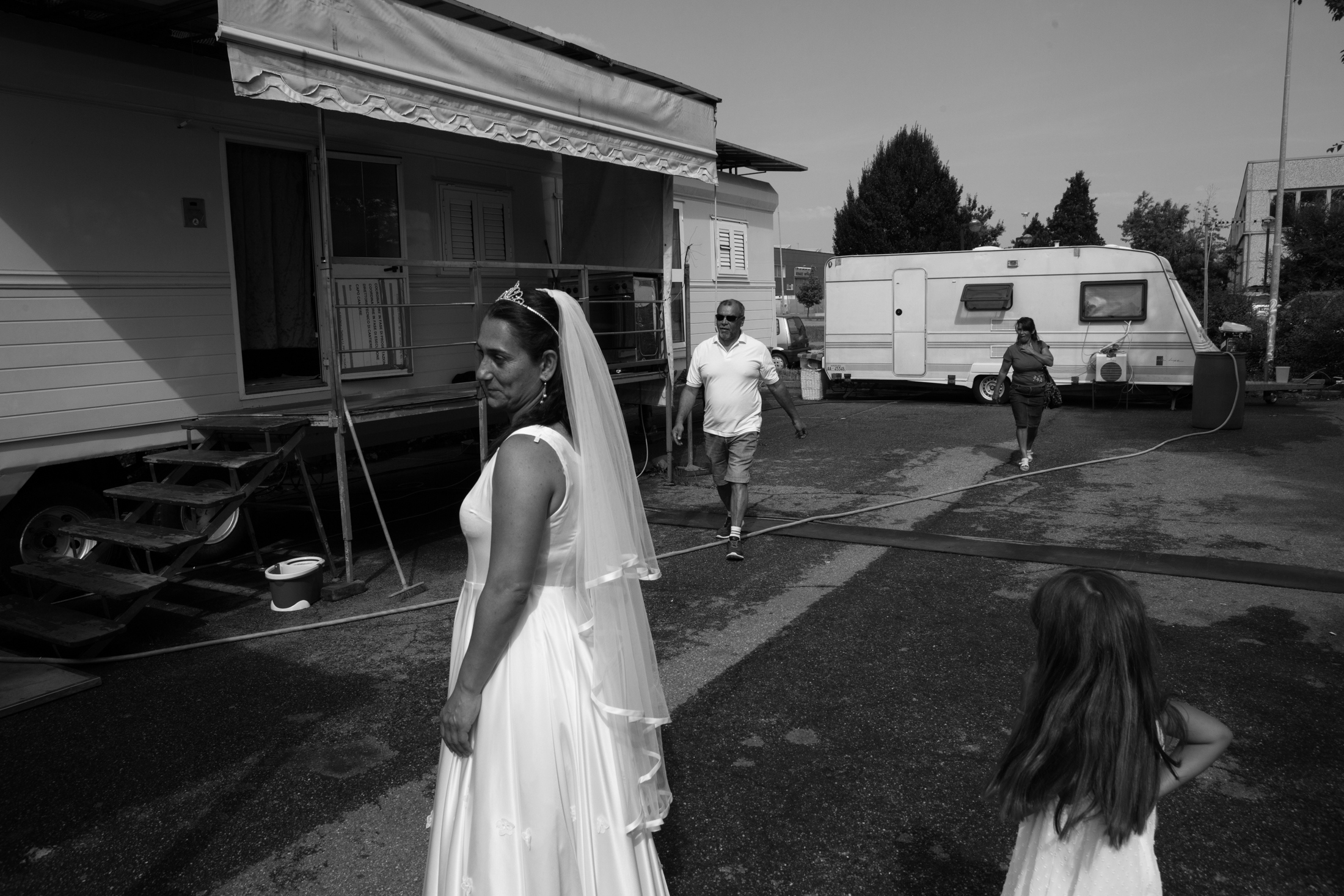 August 2018, Nomad Camp near to Castelnuovo Rangone, Emilia-Romagna, Italy. Linda's cousins is dressed up for starting her evangelical baptesim cerimony. The evangelical religion is becoming more and more established within the community, thanks to the possibility of redeeming oneself from sins and of embarking on a new way of life. In fact, these cults are reaching ever greater numbers of believers through adult group baptisms and children.