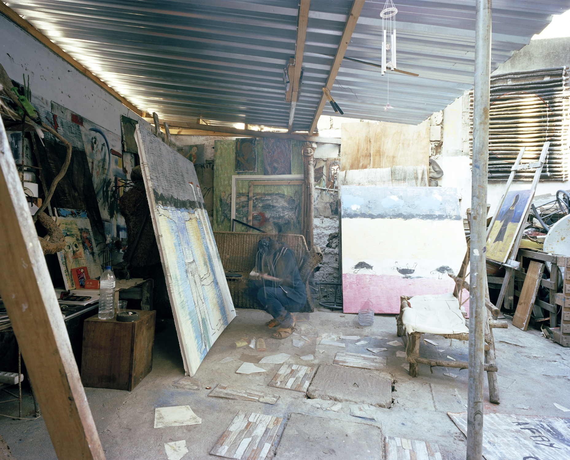 Butcheca painting at his studio, Maputo, Mozambique. July 2016. This image was made with color film with a Mamyia 7II camera, in 6x7 format. It was scanned by the artist with Hasselblad flextight X1 professional scanner.  This has a edition of 6 + 3 PA  in the size 75x94 cm. It is printed by the artists in archival quality.