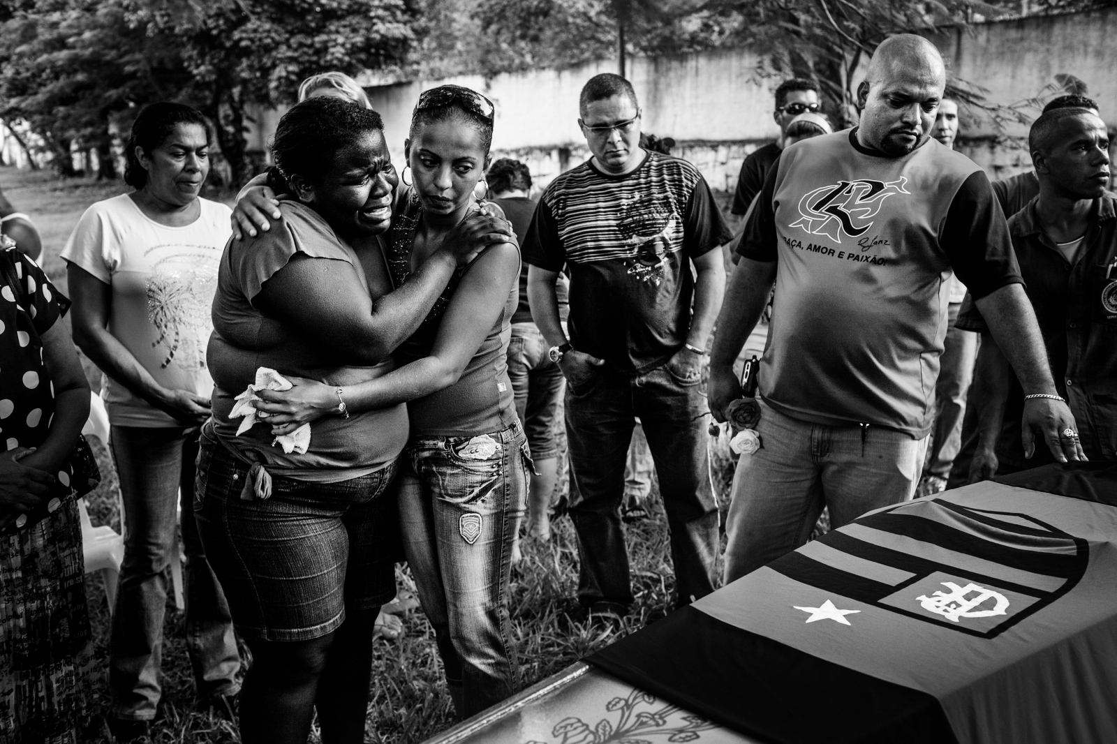 Family and friends of Weslei de Oliveira Batista during his funeral. Weslei was a military police officer who was shot dead when he tried to stop a carjacking. Rio de Janeiro is the world's most dangerous city for policemen – 146 were killed in 2016. Most officers are killed when off duty and identified as a policeman. April 2009.