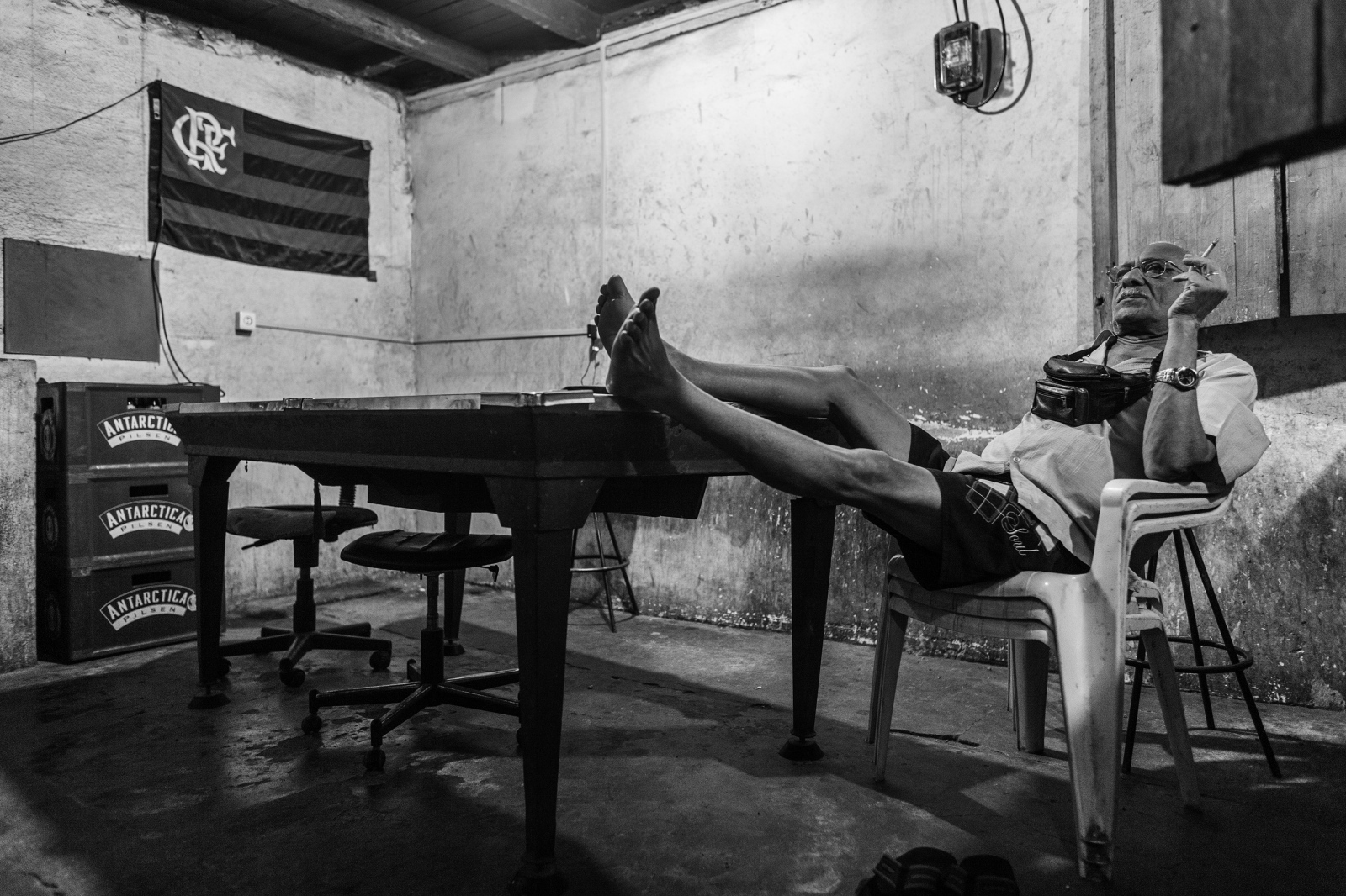A man watches television in a bar in the Dona Marta favela. November 2009.