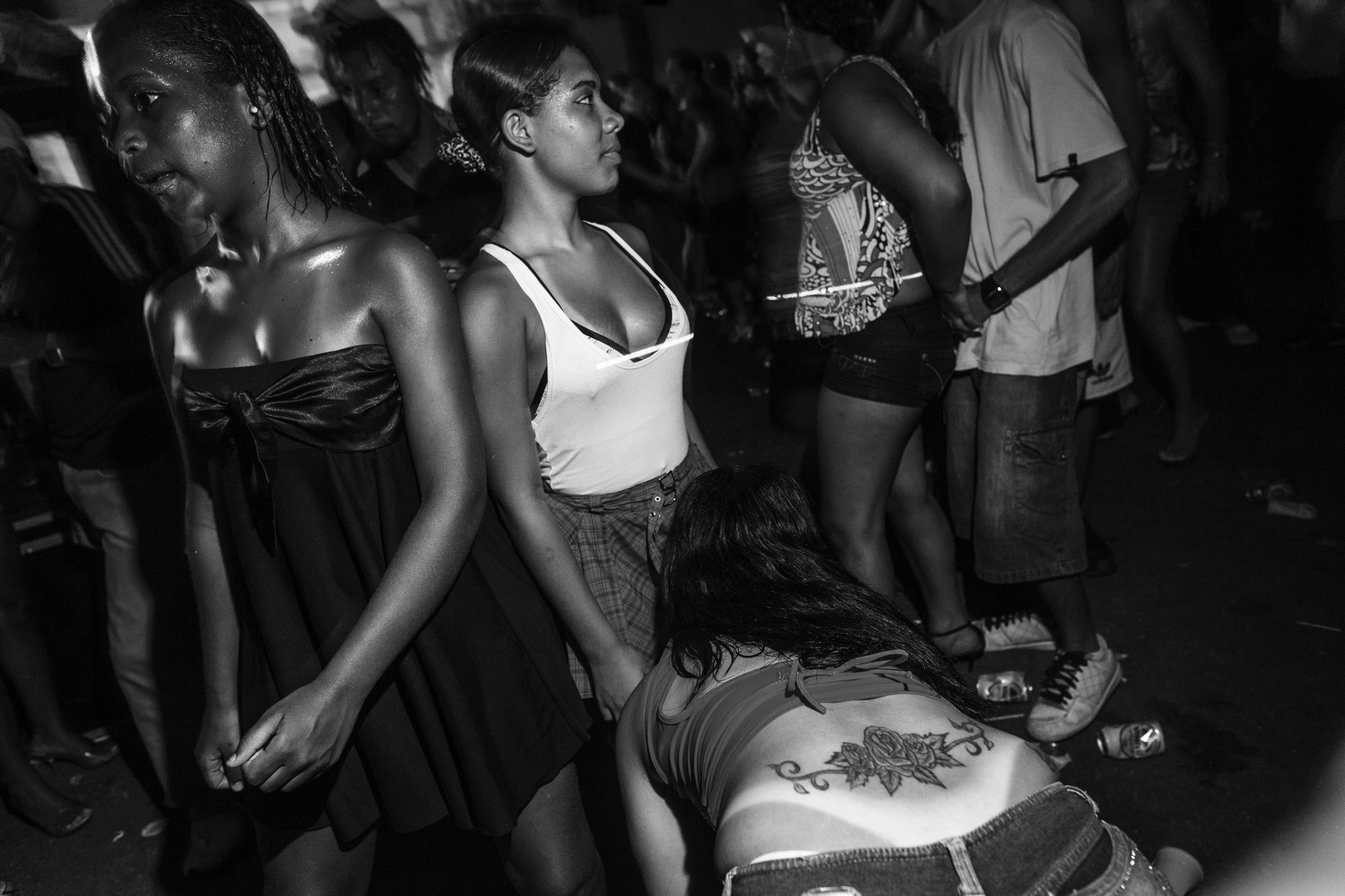 Young women dance carioca funk at a party in Rocinha favela. Carioca funk is a music style born in the favelas of Rio de Janeiro to represent the lifestyle of the slums. Now, many of its lyrics are pornographic and extremely violent. November 2009.