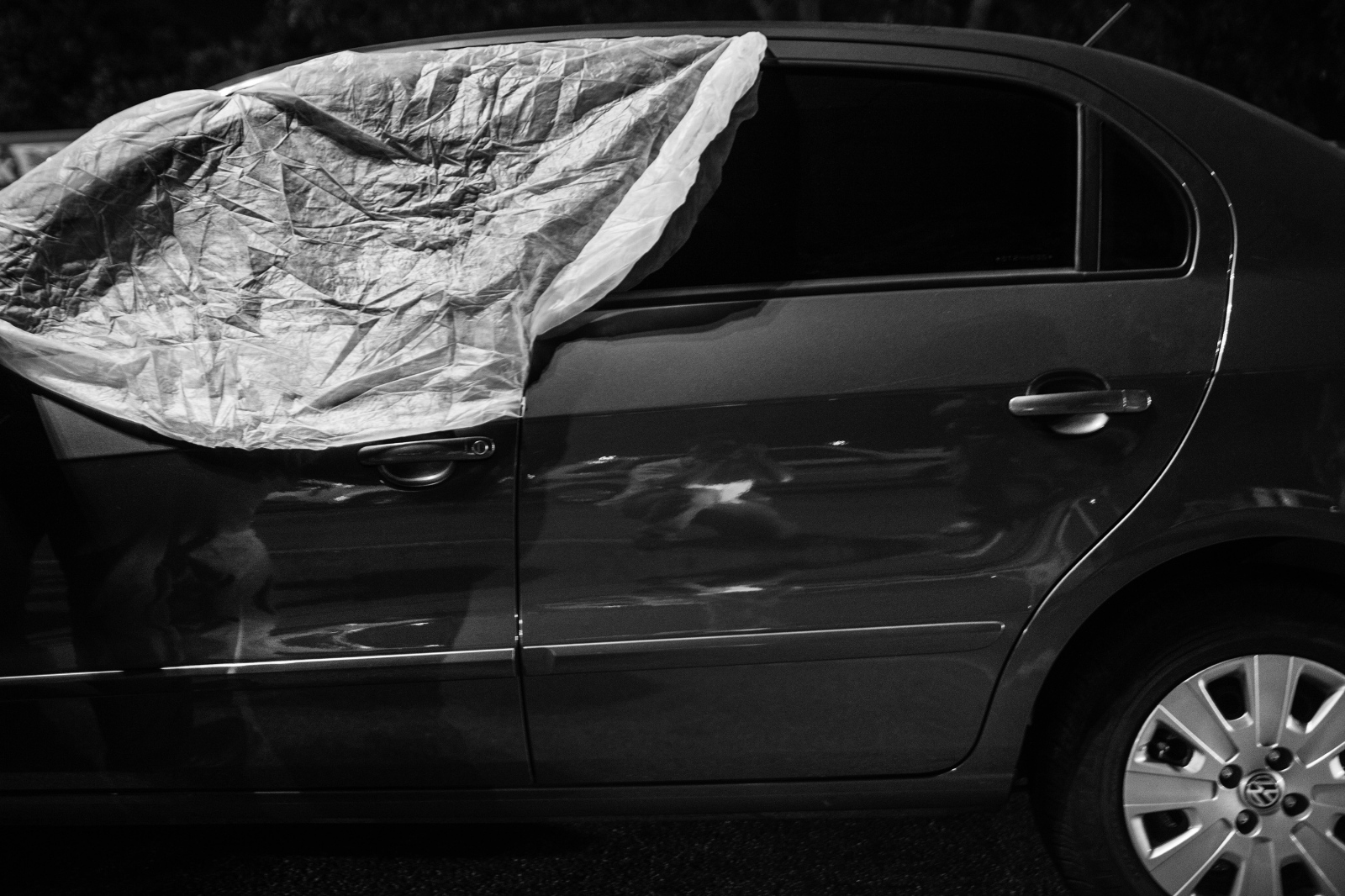 A car window covered by the homicide division of the civilian police, where a man was killed with multiple gunshots to the head and chest during a car jacking attempt in Meyer. July 2011.