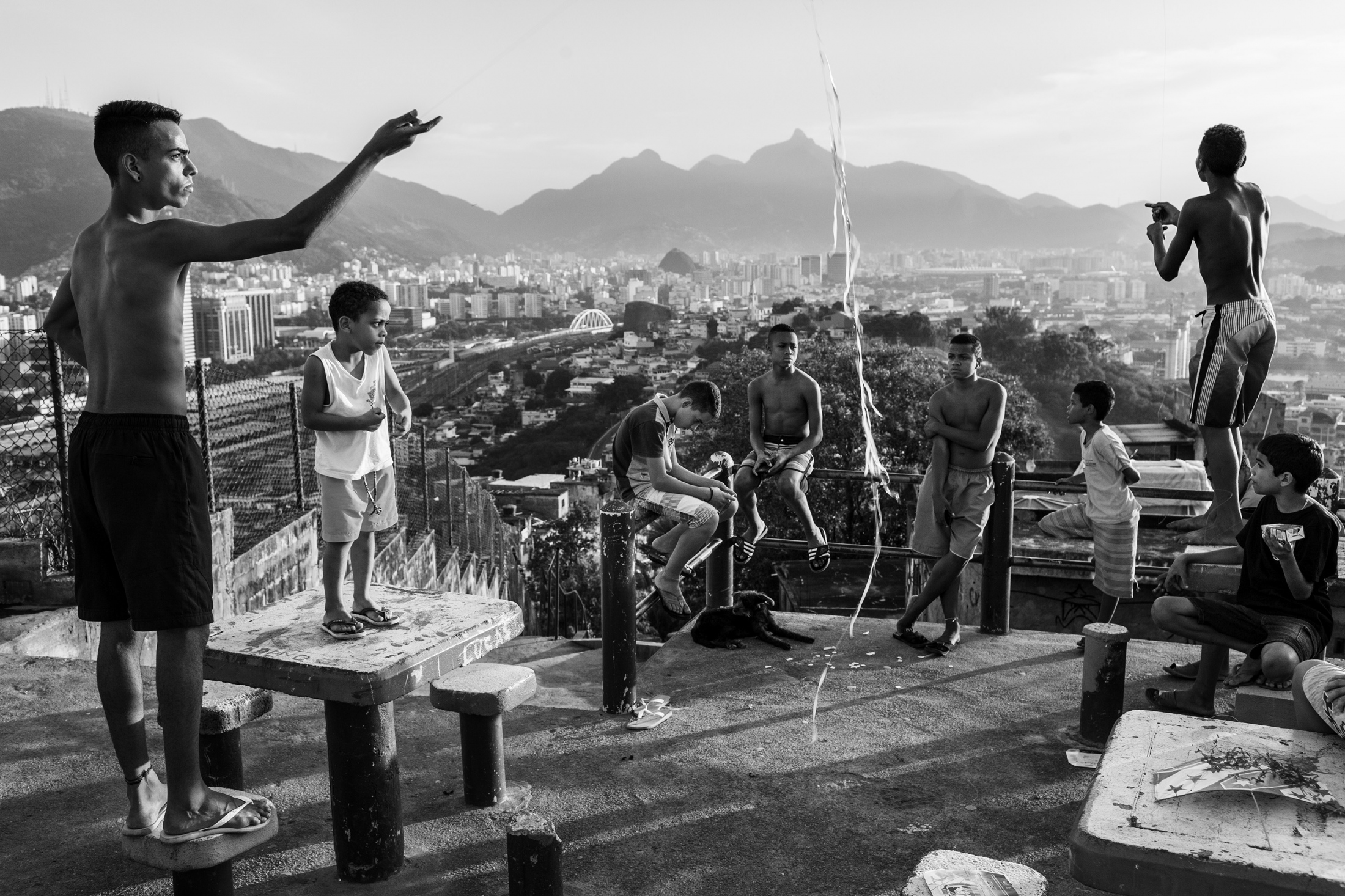 Young boys play with kites in the Providência favela. During the FIFA World Cup in Brazil, the schools of Rio de Janeiro remained closed, leaving the youngsters with nothing to do for a whole month. June 2014.