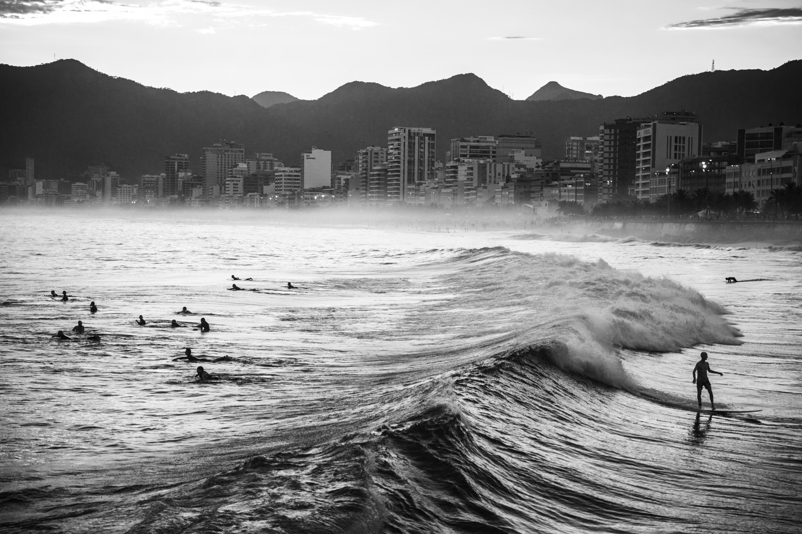A man rides a wave at Arpoador beach, Ipanema, southern Rio de Janeiro. April 2016.