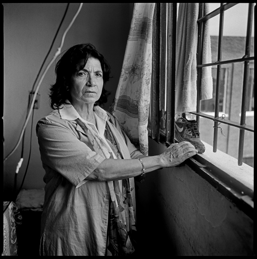 Anahit Aharonian, looking from the window of her former cell in the Punta de Rieles prison in Montevideo, Uruguay.  Ms Aharonian is a descendant of survivors of the Armenian genocide and was born in Uruguay. She became involved with politics in her teenage years and embraced the Tupamaro movement. She was arrested by the military during the early days of the Uruguayan dictatorship, having spent 12 years in jail.  Montevideo, Uruguay, February 2012.