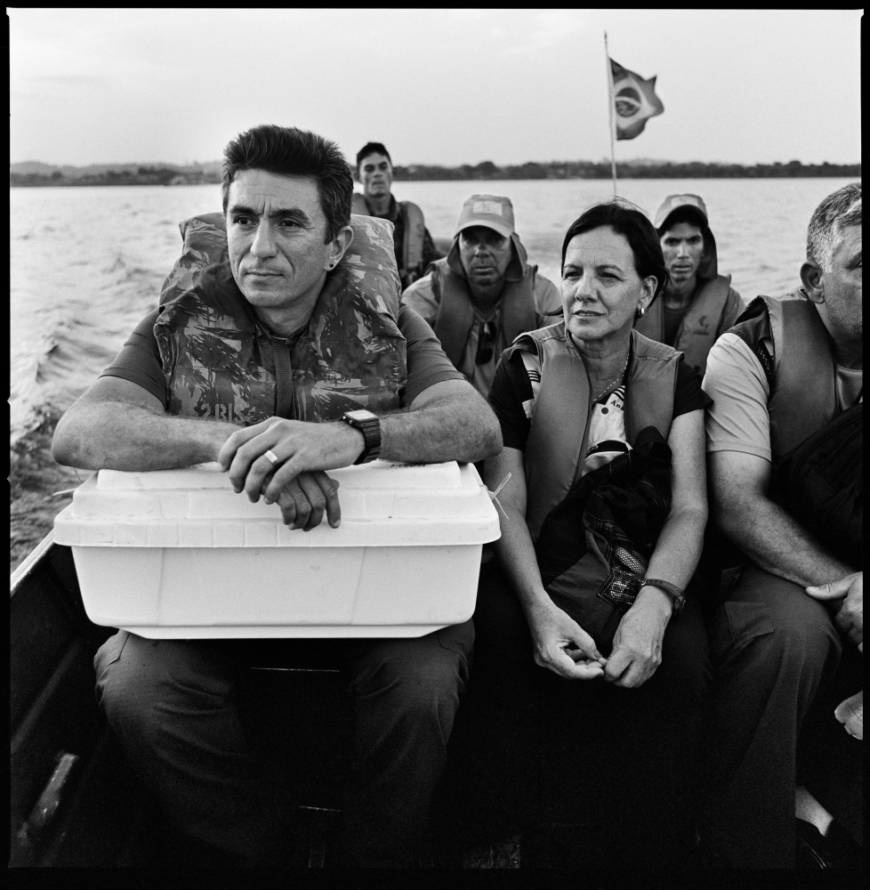 Marco Aurelio Guimaraes (L) a forensic pathologist carries the remains of what appears to be a former Brazilian araguaia guerrilla fighter while crossing the araguaia river by boat with his team back to Xambioa. Guerrilla fighters were  captured, tortured and executed in the Amazon jungle by the Brazilian Armed forces during the military dictatorship in Brazil. Araguaia river, Brazil, October 2012.