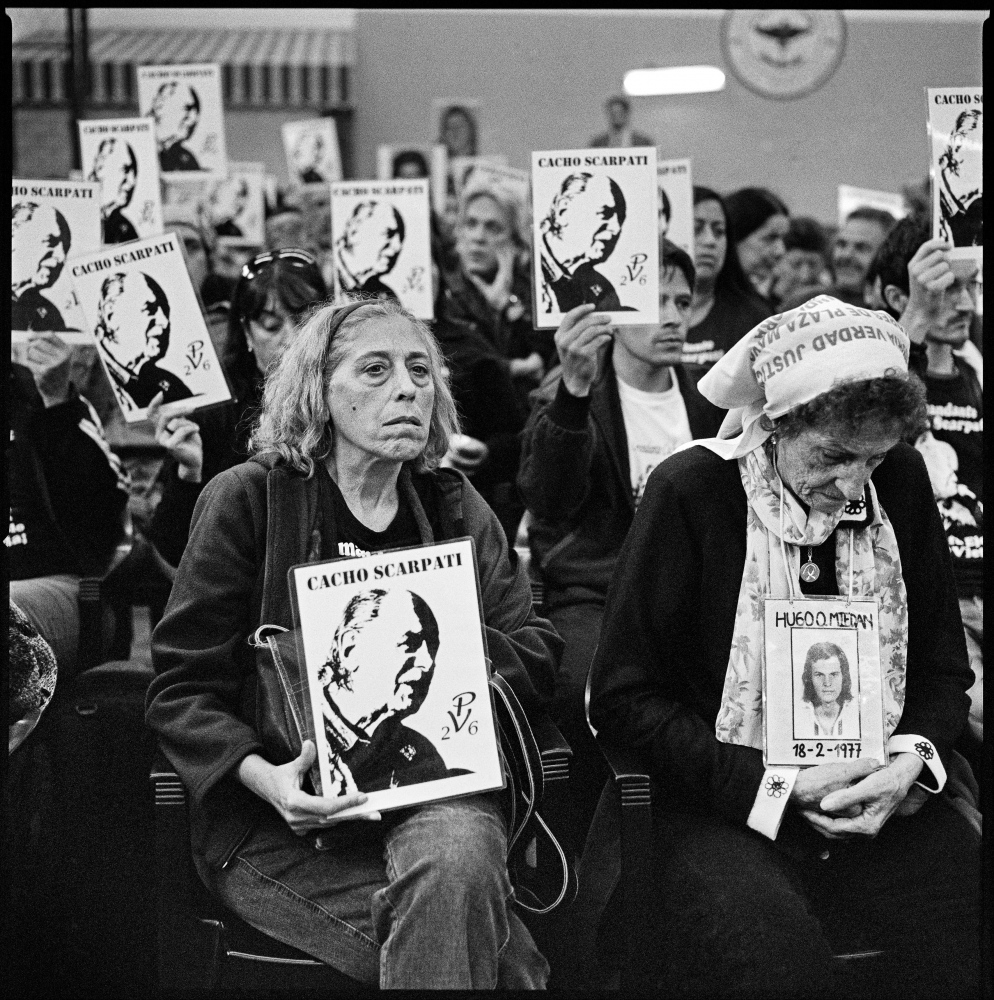 Families and friends of the disappeared during the Campo de Mayo concentration camp trial, where the former president Reynaldo Bignone was sentenced to 25 years in jail for crimes against humanity.  Florida, Argentina, April 2010.