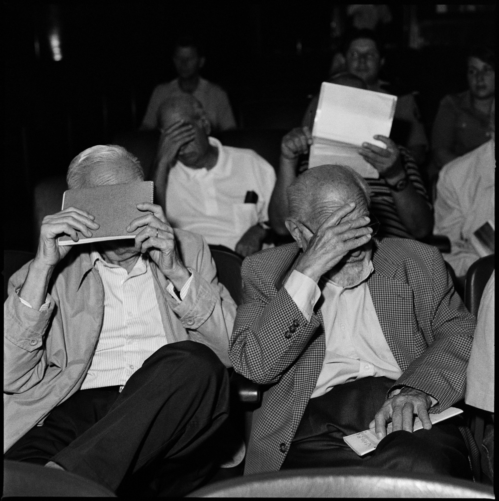 Former military men, hide their faces to the photographer during a session of their trial in which they are being accused by the Argentine state of crimes against the Humanity in the last dictatorship from 1976-1983.  Bahia Blanca, Argentina, February 2012.