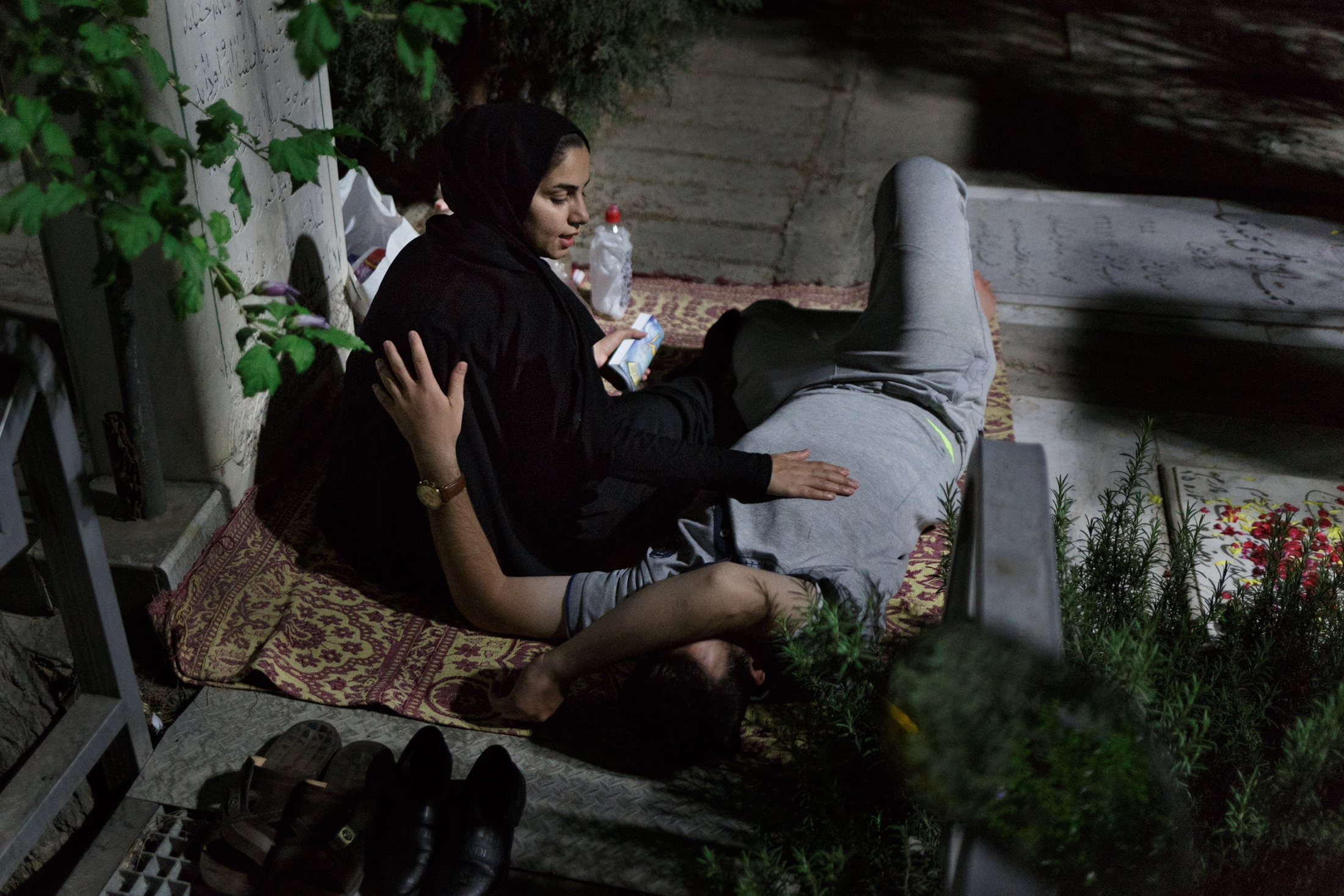 """""""It seems as we do not belong anywhere. We strive for a better life, but we can not nd it here. """"- Sara, 22, is from Sanandaj and studied psychology. She longs for a place of hope.                     A couple spending the second holy Lailat al-Qadr of Ramadan on Tehran's martyr cemetry. Shiites belive in the holiness of Martyrs and their valued position for Allah, why some spend their holidays near the martyrs."""