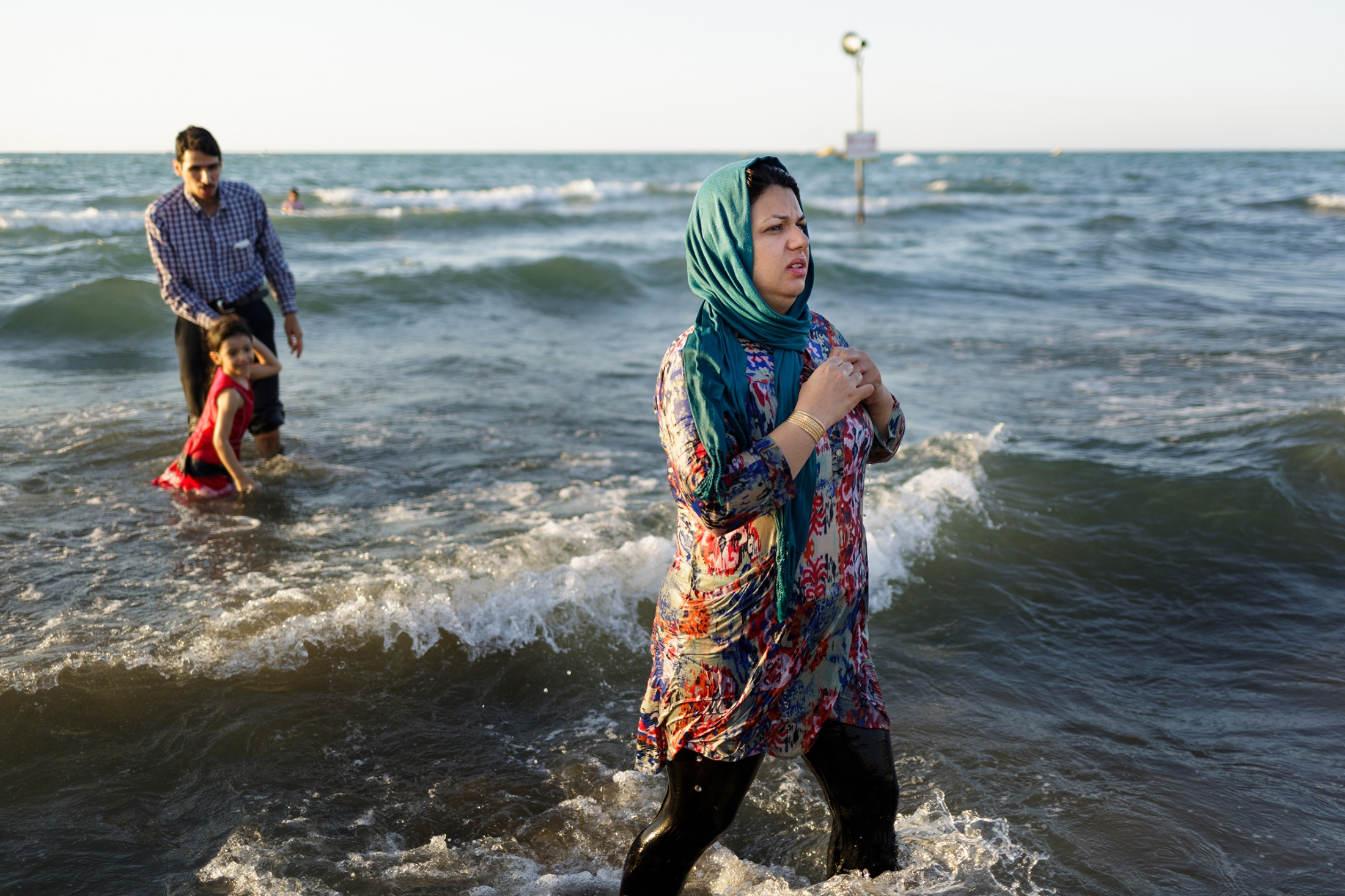 Women are not allowed to swim in public in swimwear, so beaches have separate areas for them. However, they often go into the water clothed, because these areas are sometimes closed or too far away.