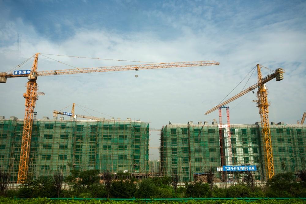 Especulación inmobiliaria en X'ian, al igual que en la mayoría de las ciudades de China. Los edificios son construidos usando andamios tradicionales de bambú/ Real state speculation in X'ian like in most cities throughout china. Buildings are erected using tradicional bamboo scaffolding. Xi'an