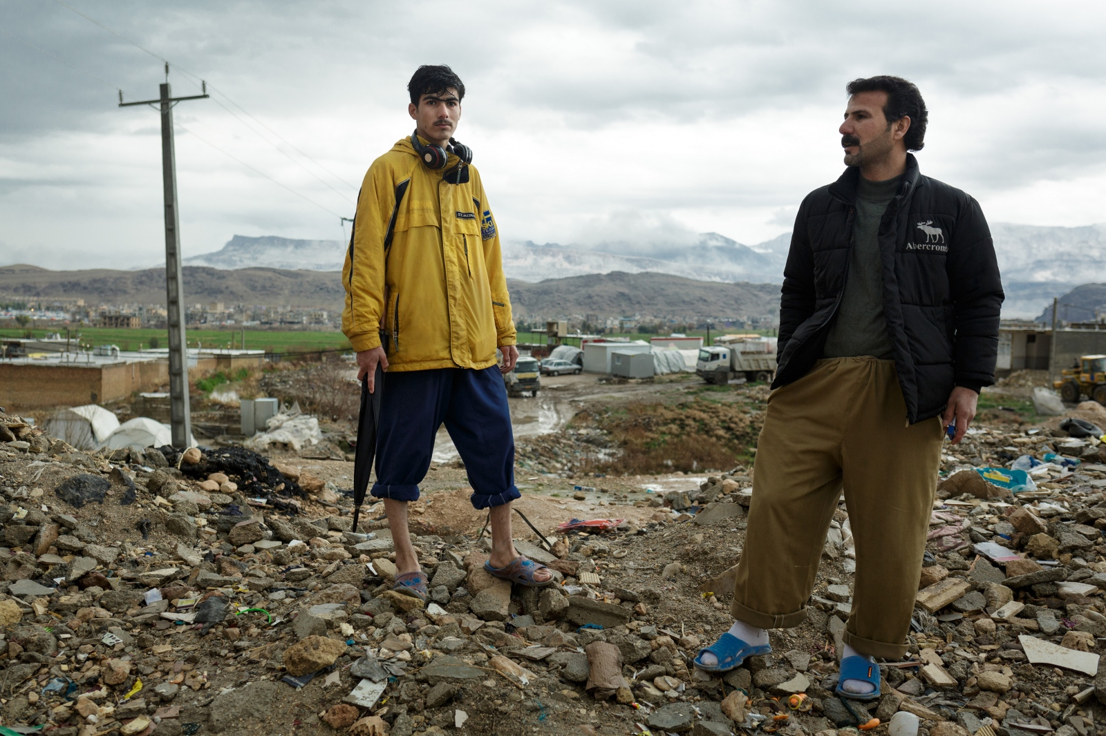 Two men whose homes in Sarpol-e Zahab are destroyed during the earthquake in south-western Iran on November 12th, 2017, stay on a hill over their residental area.