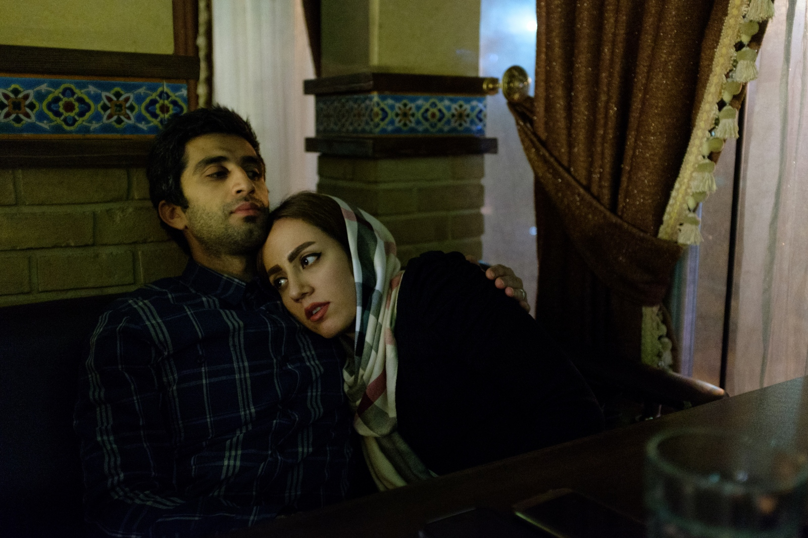 Hamed and Hode listen to music in a restaurant in Tehran. They fell in love during their study and married four year later.