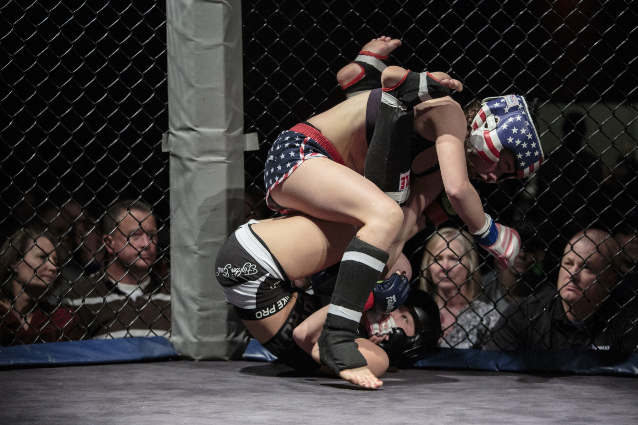 Shaniyah Carlson, 15, top, competes against Teddy Mandala, 14, during the U.S. Open Youth National. Youth MMA fights are similar to adult matches, except for shorter rounds and limited moves for safety.