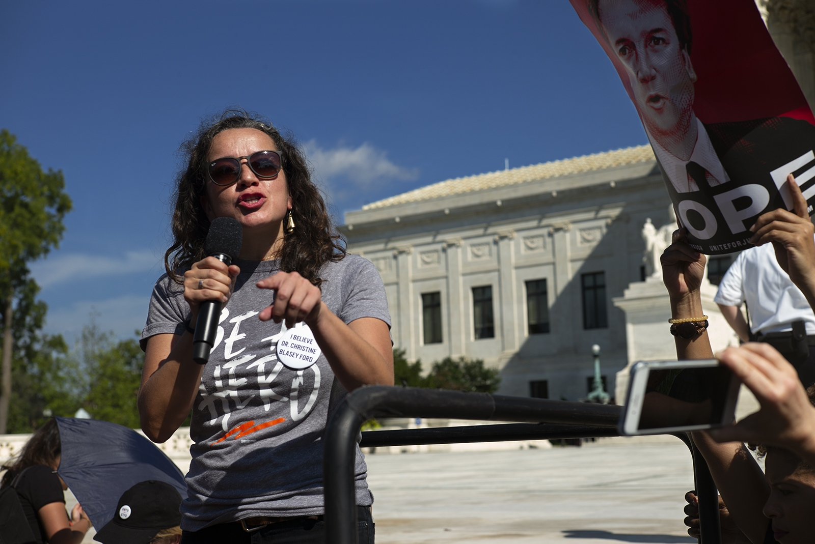 Ana Maria Archila, one of the women who confronted Senator Jeff Flake in an elevator, speaks to a crowd in front of the U.S. Supreme Court building.