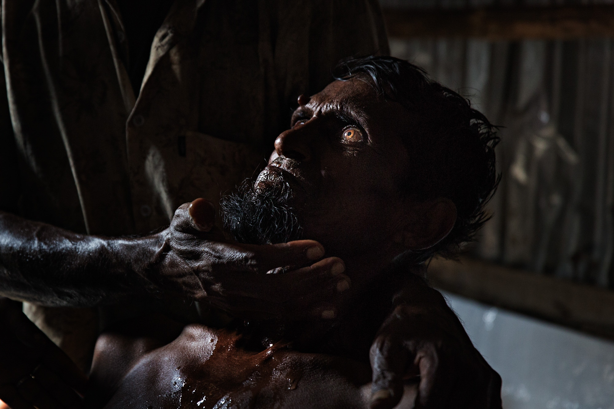 Nesar Ahmed, 65, is treated in a makeshift MSF clinic after crossing the Naf River from Myanmar into Bangladesh. His condition was deemed critical and the BGB allowed him to be carried out of the rice paddy field where tens of thousands of others waited throughout the day and night.