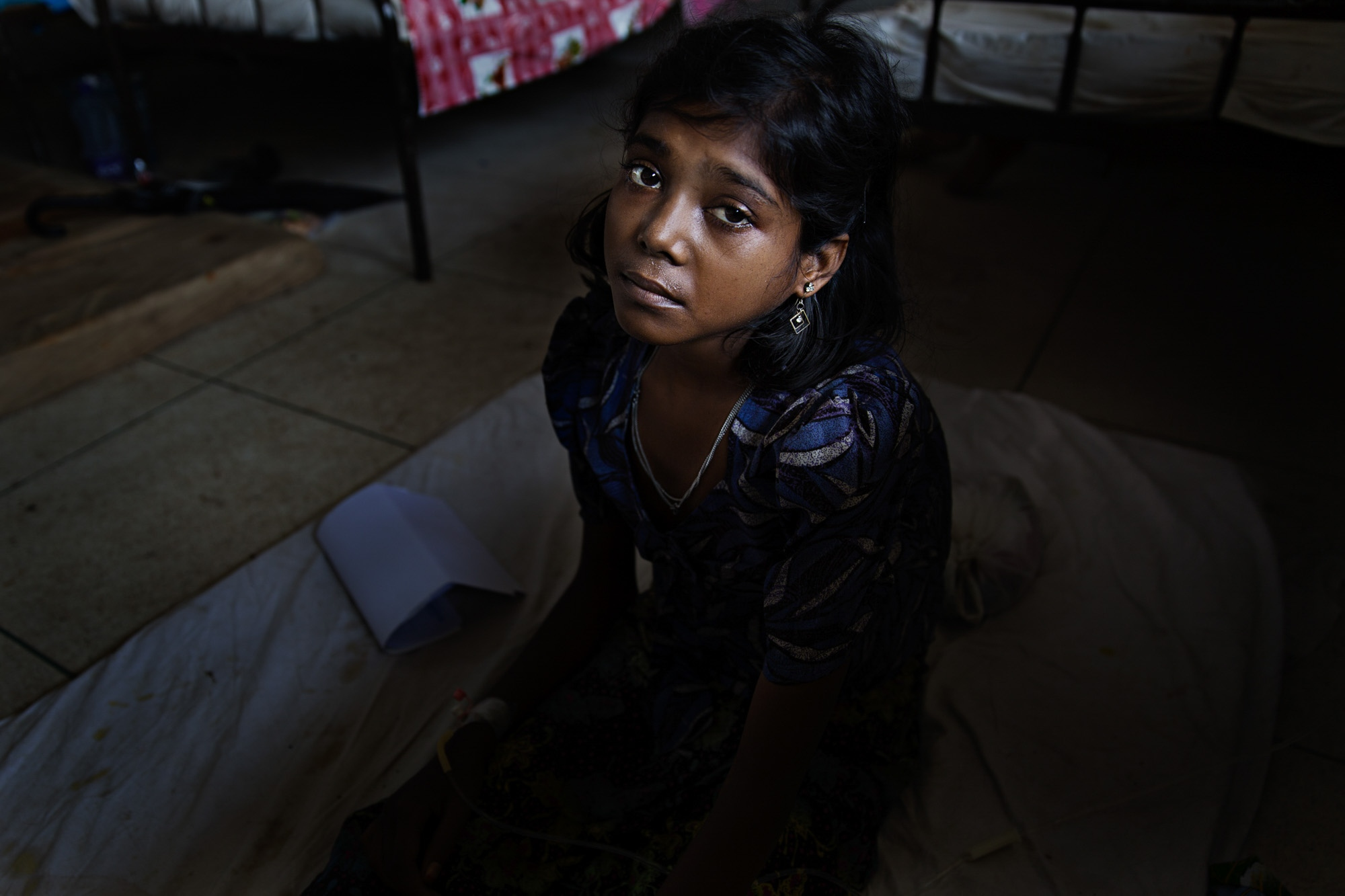 Saleha, 16, suffering from malnutrition, sits in Sadar Hospital in Cox's Bazar. She lost her parents on the way to Bangladesh, but is occasionally visited by her sister who lives in the camps. However, she spends the majority of her days alone.