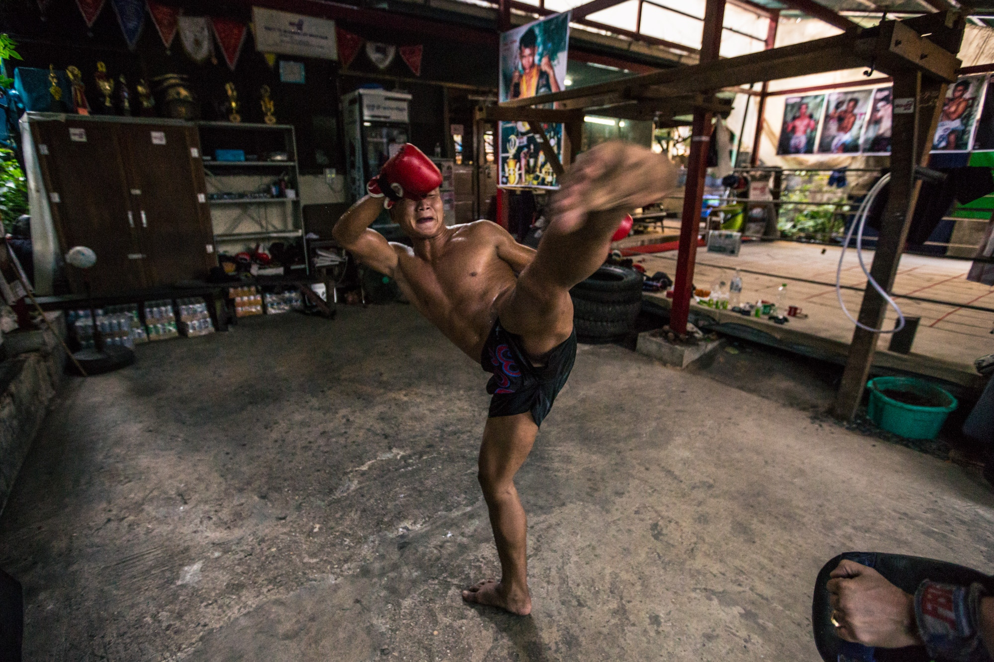 Saw Gaw Mu, a professional Let Wei (Burmese boxing) fighter practices at Thut Ti boxing gym in Yangon.