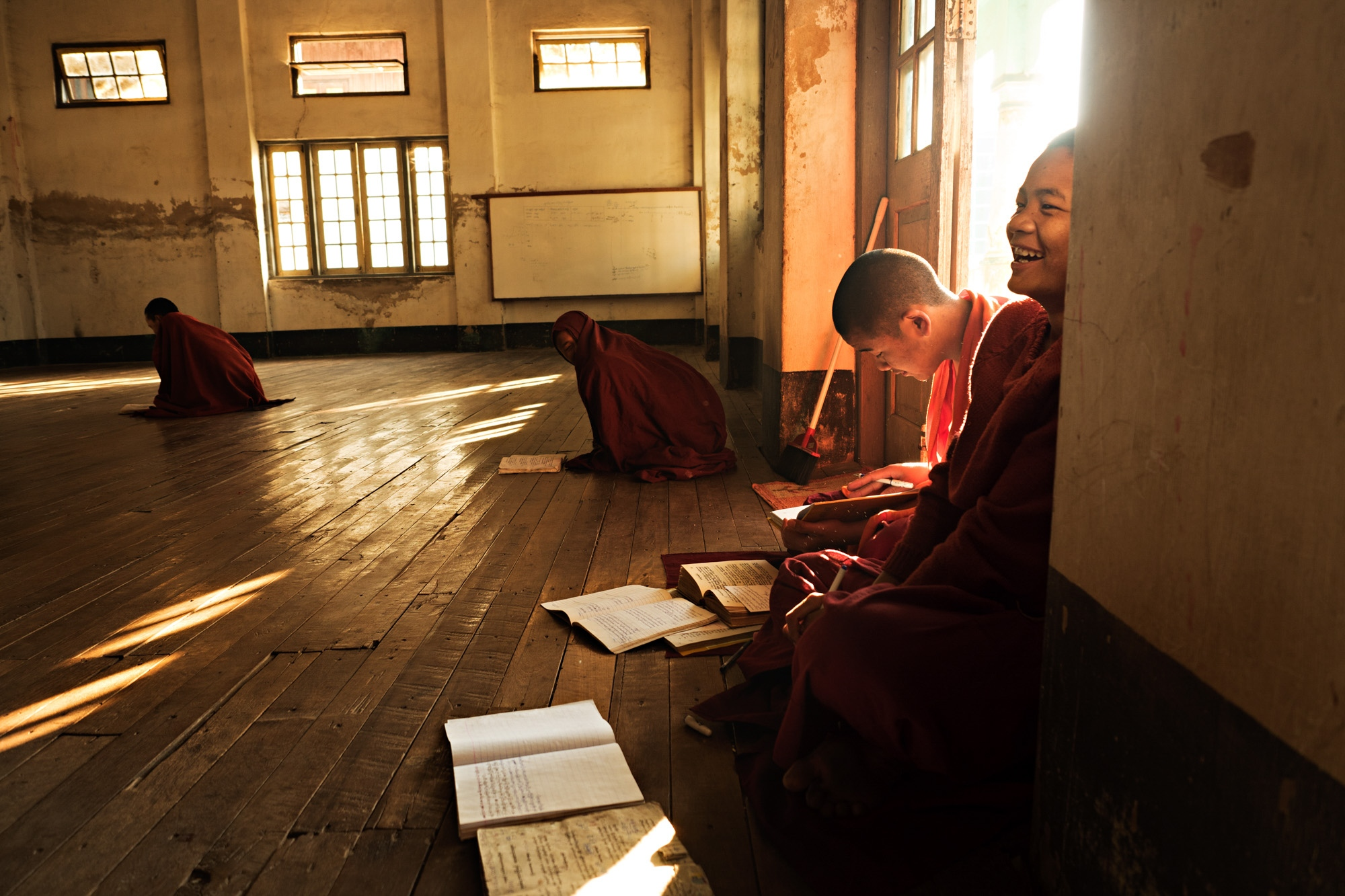 Novice, Buddhist monks study at a small temple in Nyaungshwe.