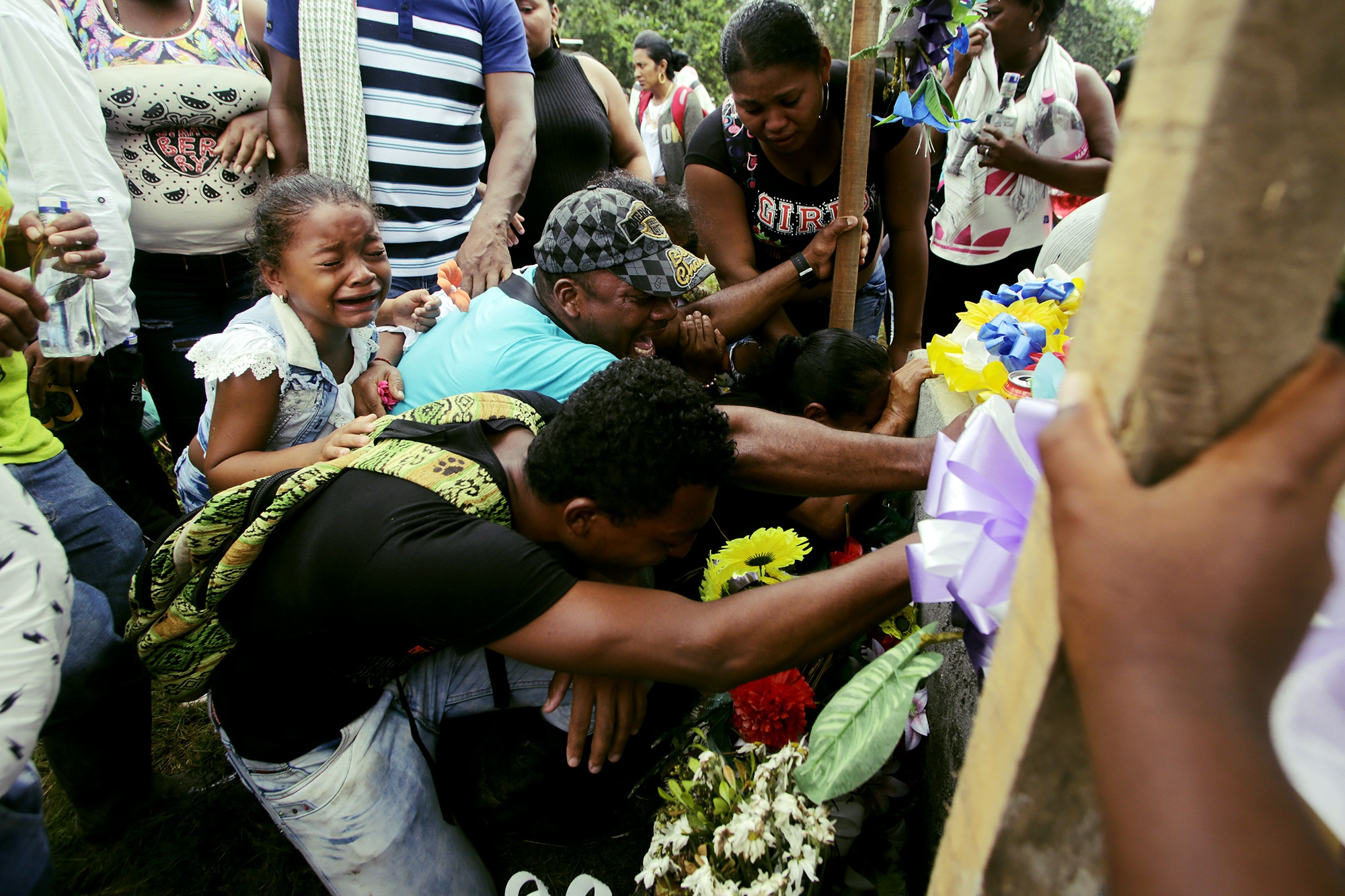 "Relatives of one of the dead in ""El Tandil"", Nariño, Colombia, mourn their loss in the cemetery of the area of ""El Playón"""