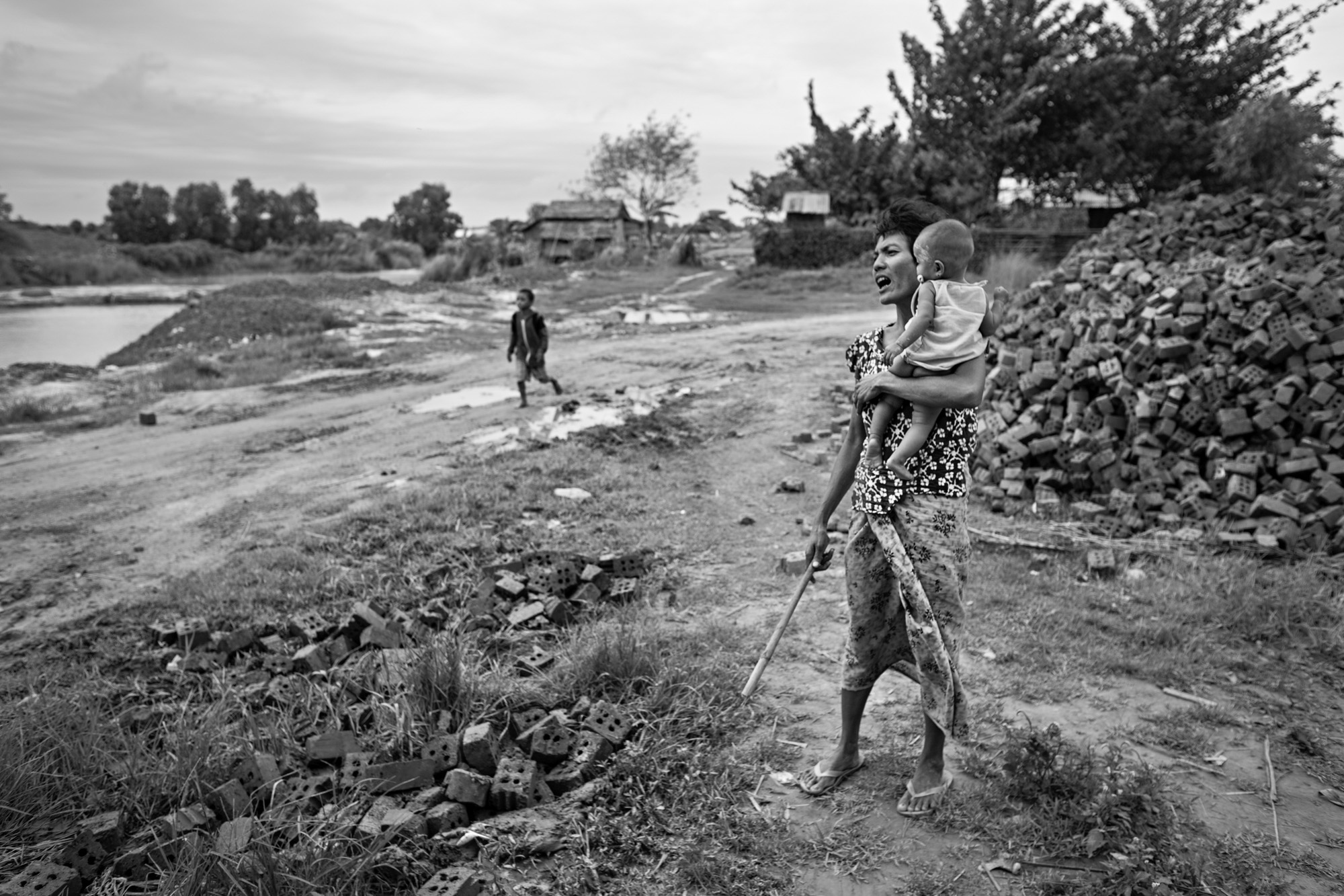 Than Nwe yells for her children to return home in the evening.
