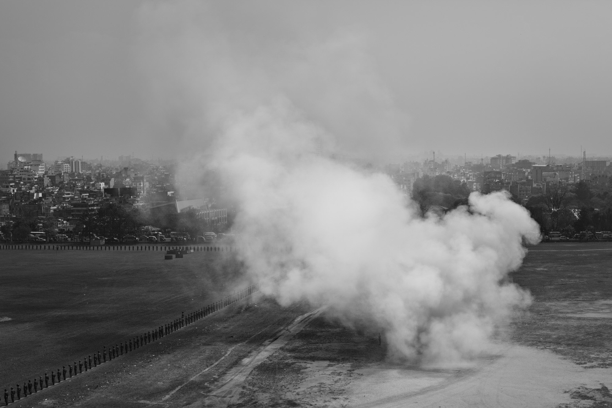 Smoke rises from canon fire during a military demonstration in Kathmandu.