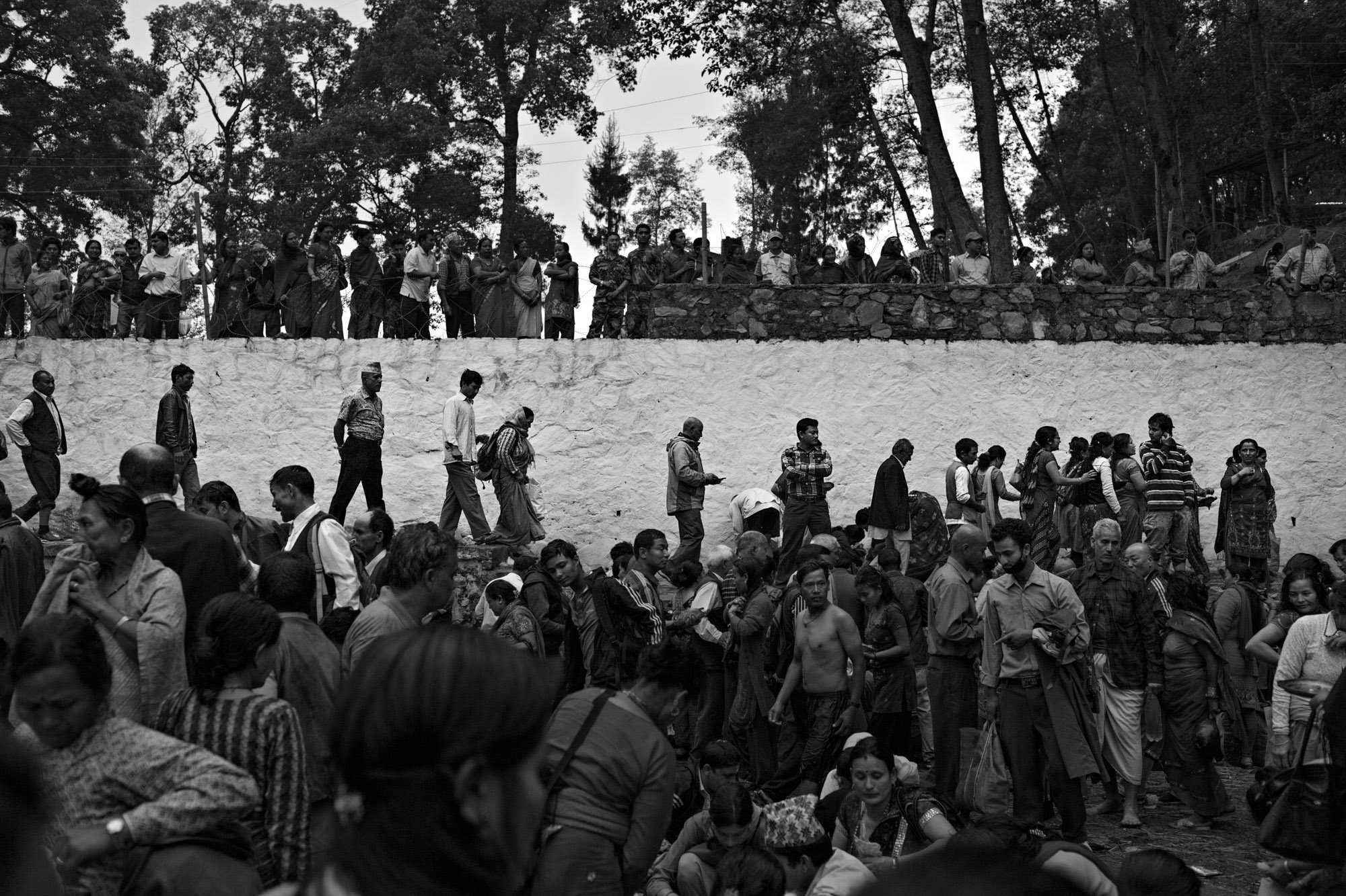 People gather at a sacred area on the outskirts of Kathmandu on Mother's Day, to honor their deceased mothers and grandmothers. This is a special gathering only for those whose mothers have died.