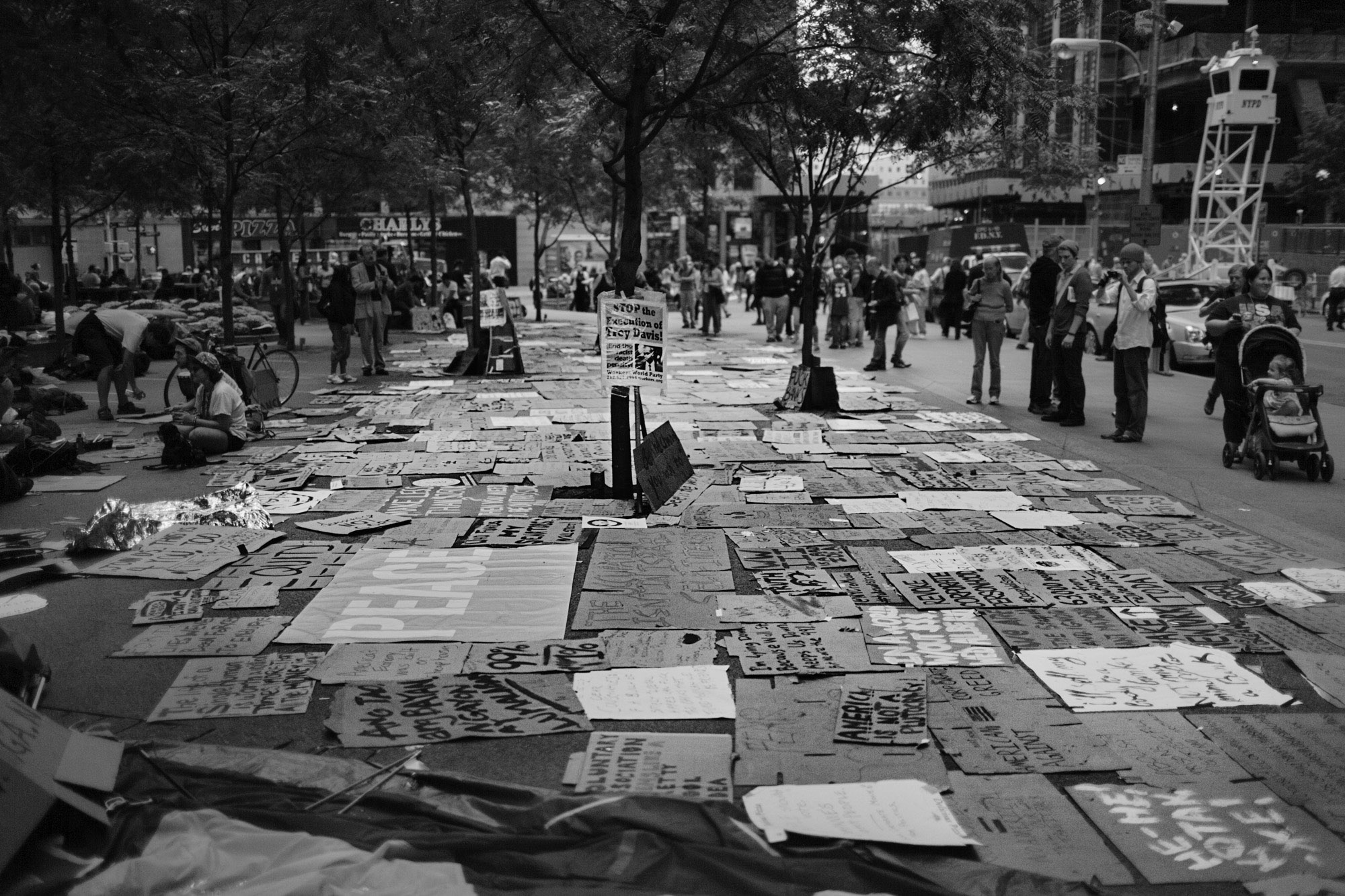 Protest signs lay on the ground at Zuccotti Park.