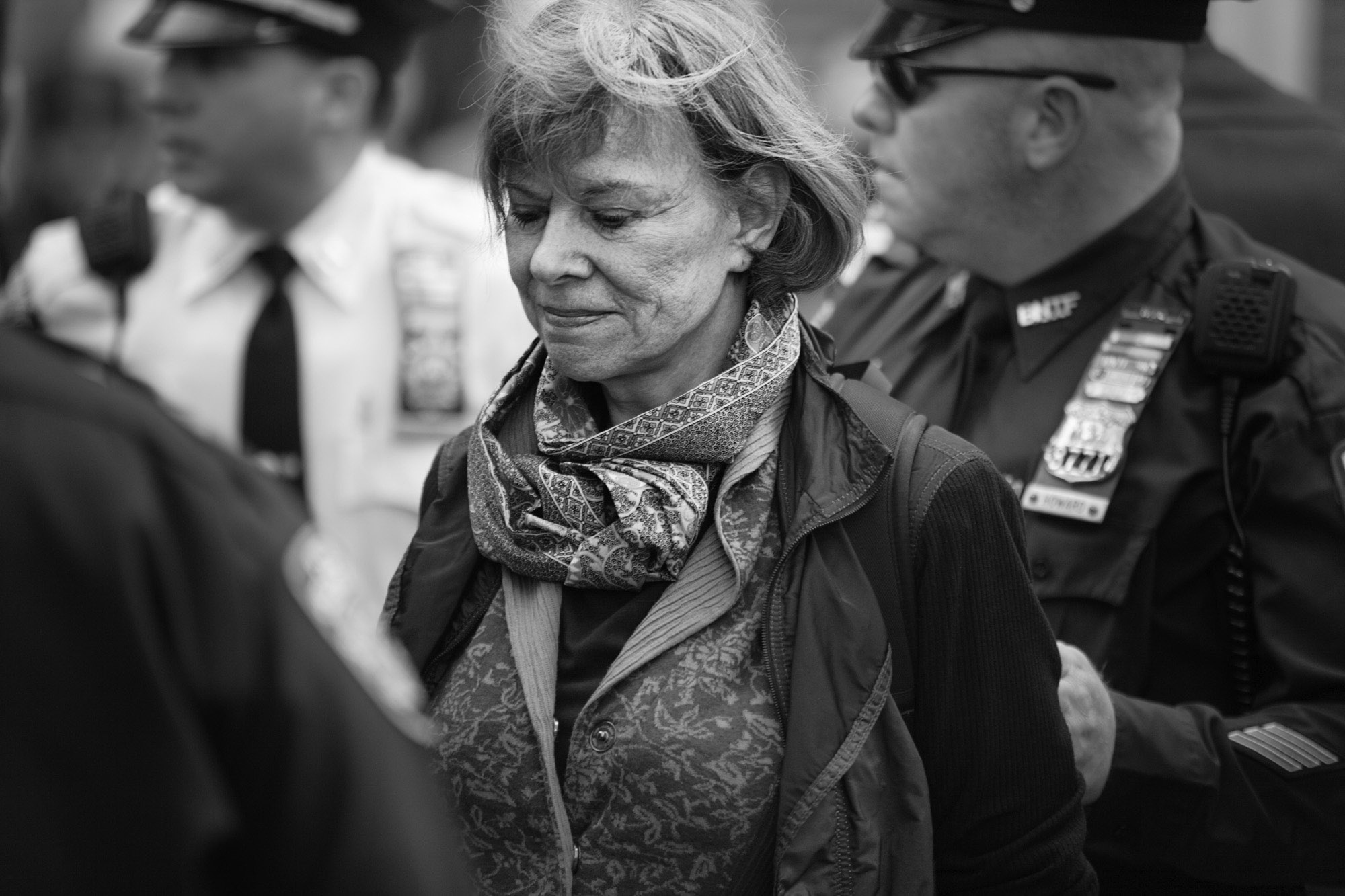 An OWS protestor is arrested and led away by police.