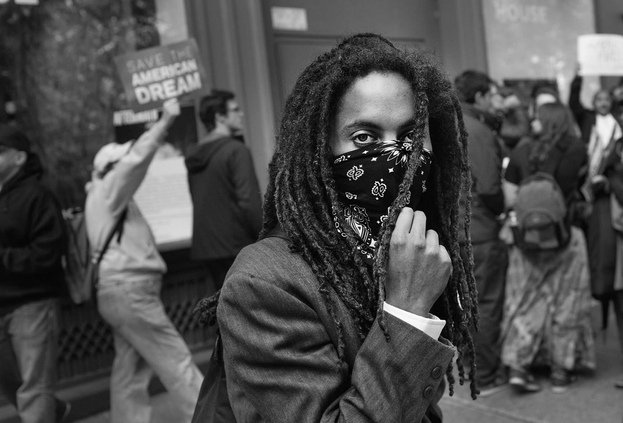 An OWS protestor stops to look into the camera during a march to Union Square.