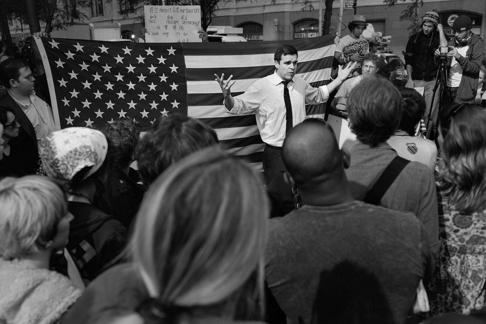 A man delivers a political speech to anyone who will listen at Zuccotti Park.