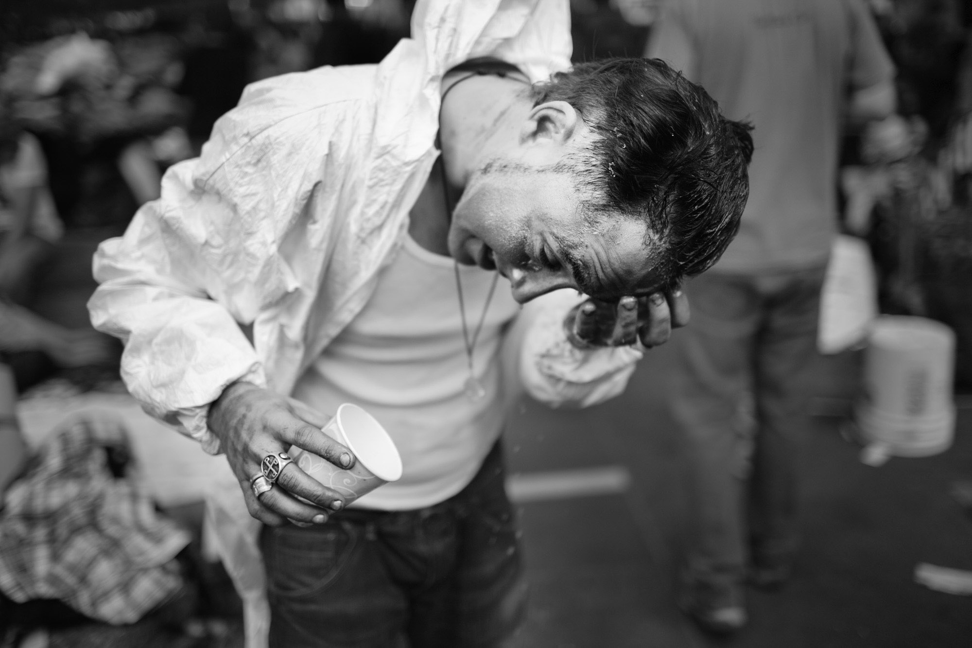 An OWS protestor washes paint off of his face after a demonstration.