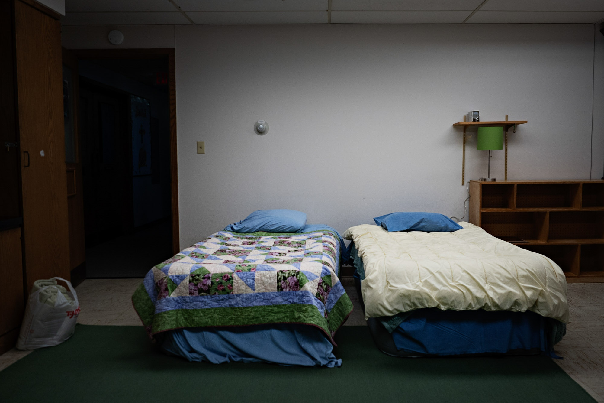 Ready-made beds are seen in a small basement classroom of the First Presbyterian Church in Plattsburgh, N.Y. The room is kept ready and available to asylum seekers who might need a place to stay before crossing the border.