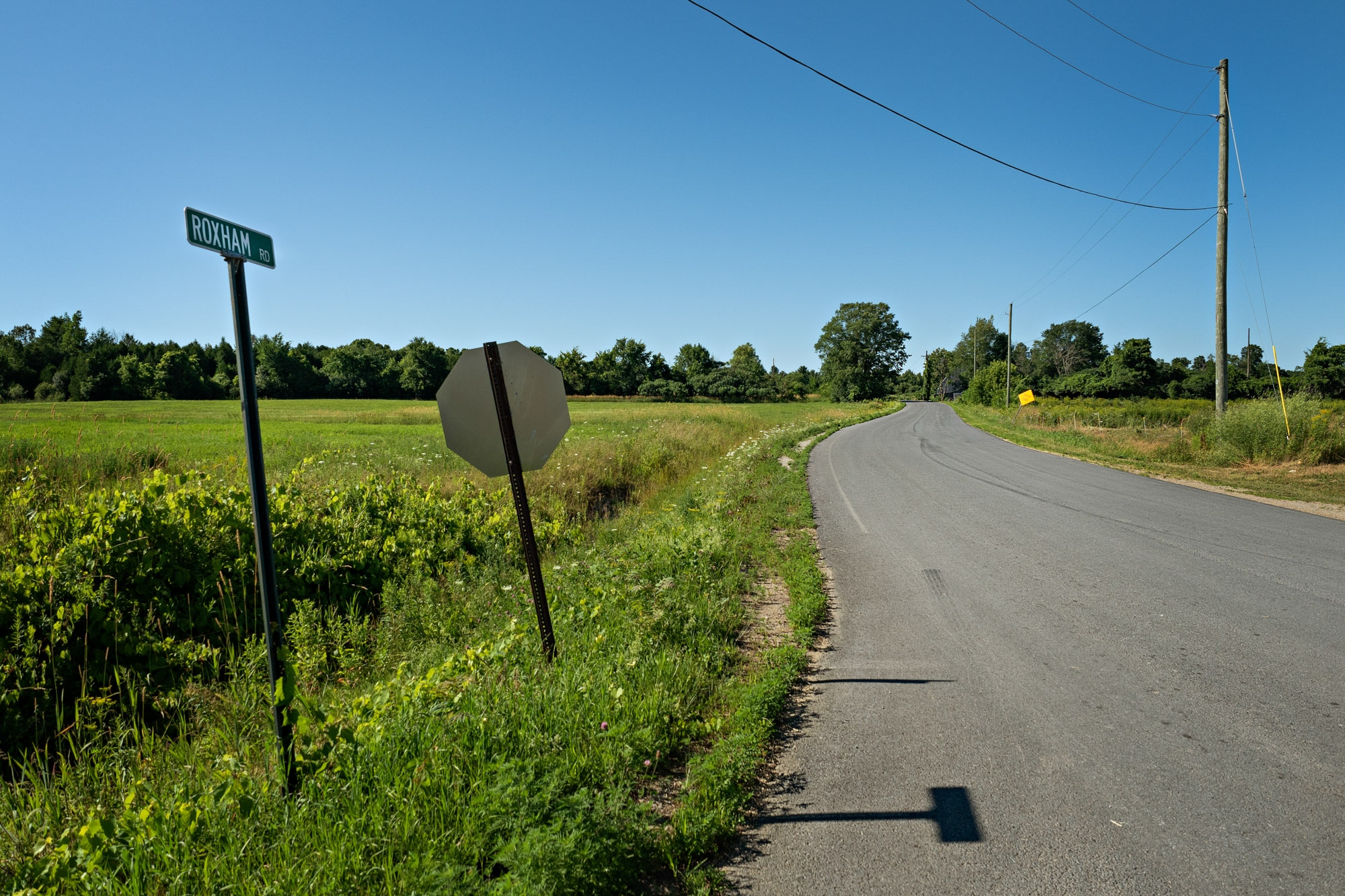The beginning of Roxham Road, in Champlain, N.Y., where it intersects with the famous North Star Road — said to have been a guiding light to slaves on the run nearly two centuries ago.