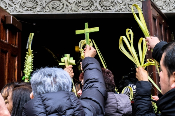 Late-comers stand outside St. Bartholomew Church on Palm Sunday. March 2017