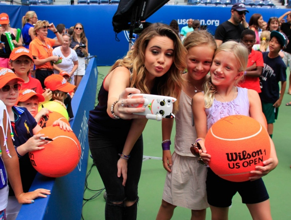 Actress Laura Marano with two young fans at the US Open's Kids Day. Flushing Meadows, August 2016