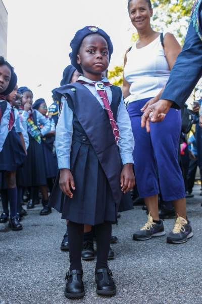 Member of Pathfinders, Seventh Day Adventist's scout organization, lines up for march. Jamaica, September 2017