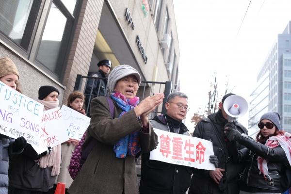 At protest outside the 109th Pct., mother of sex worker Song Yang who died during police raid. Flushing, December 2017