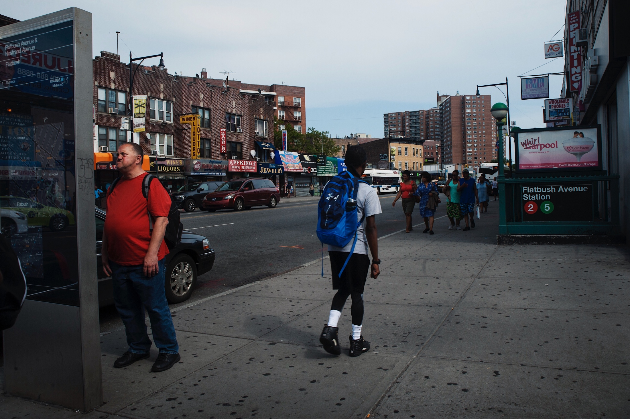 A passerby looks at a map at the intersection of Newkirk & Nostrant in Flatbush, New York.