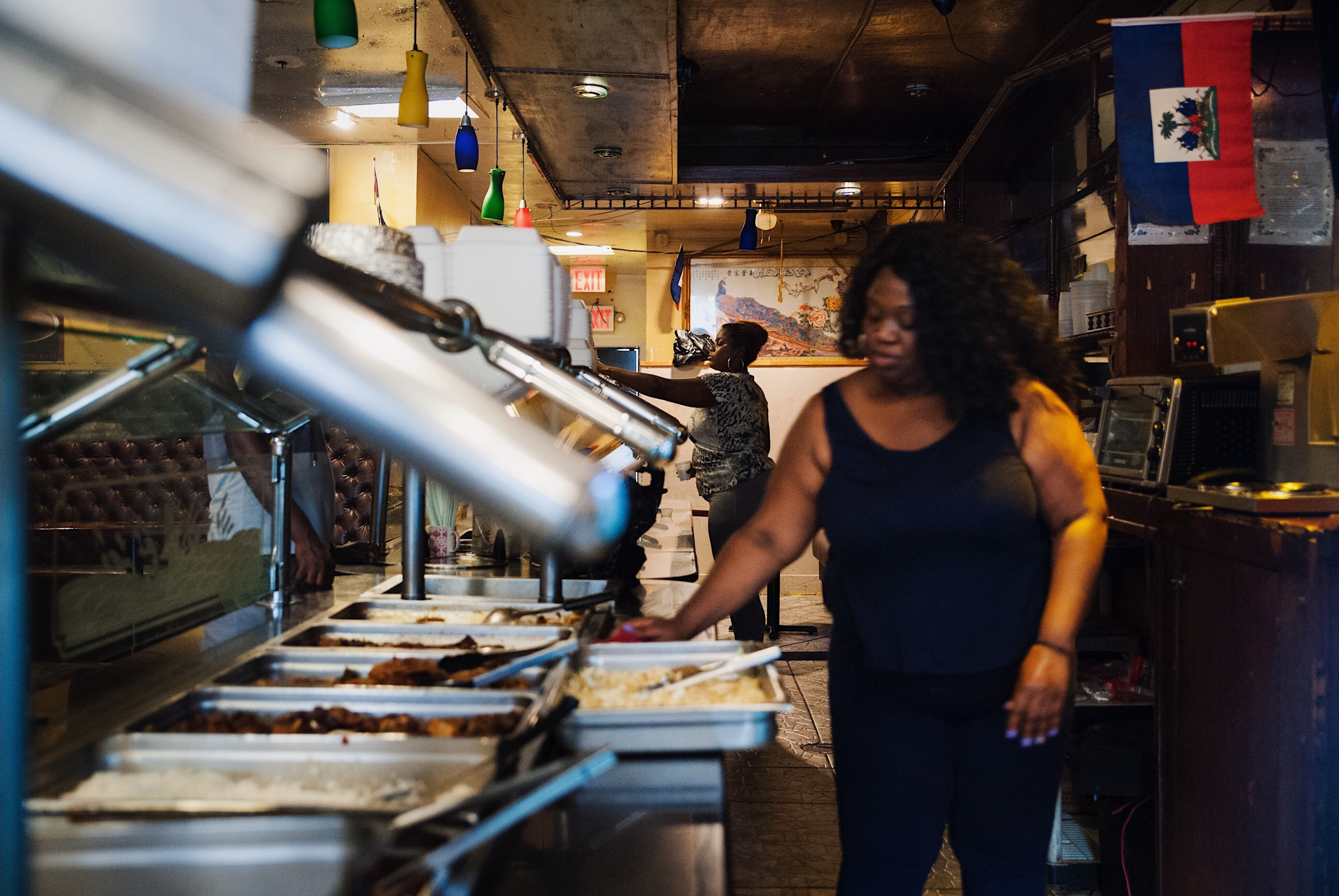 Servers cater to guests at Exit Creole Restaurant on 1805 Nostrand Ave in Flatbush.