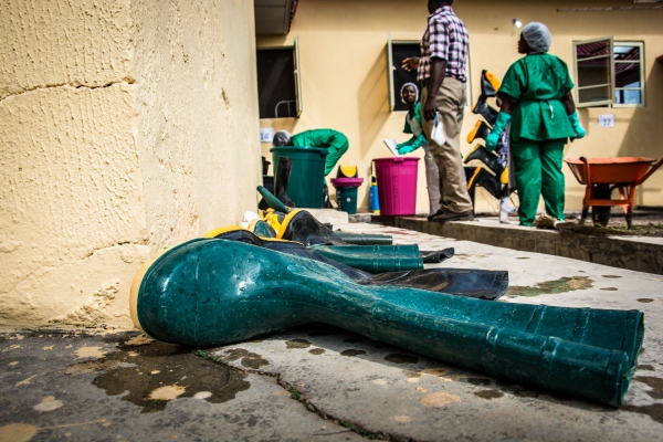Disinfected boots are left to dry just outside the Infection Control Center, Federal Medical Center, Owo, Ondo state. As a rule of thumb, reusable items are disinfected twice before they can be used again.