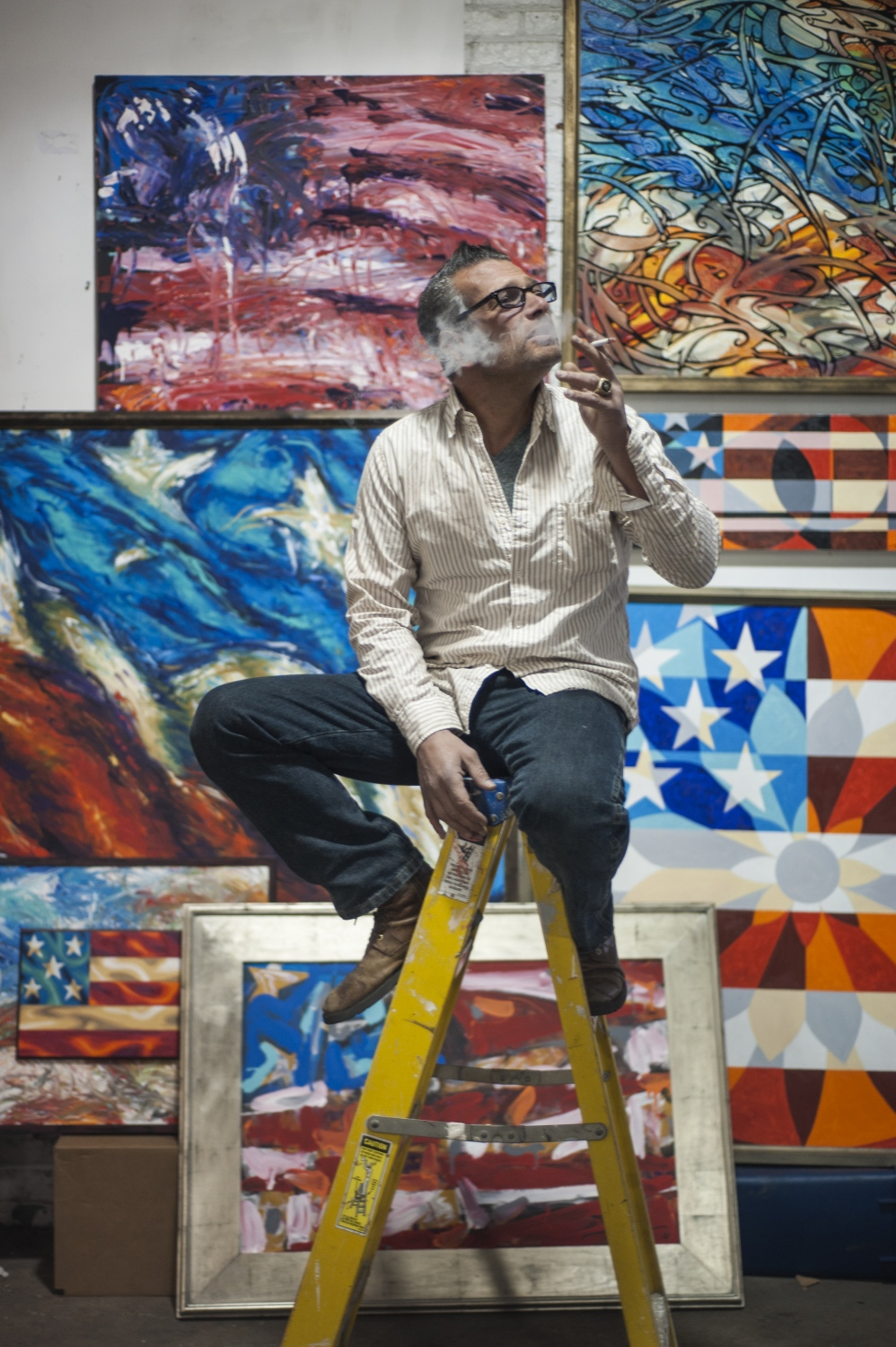 "Scott LoBaido is a painter from Staten Island who makes large-scale renditions of the American flag and abstractions of patriotic symbols. He has toured all 50 states, painting a giant flag in each state to commemorate U.S. veterans. He is also known for his vocal support for Trump in the 2016 election. As a result of his political beliefs, he said he has long been an outsider in the art world. He also said other artists who voted for Trump are wary of the media. Through his art, LoBaido communicates the romance of American nationalism that he believes has been entrenched in negativity. He says his art is for the ""deplorables – those who support Trump, work hard, and don't have time for fancy hoity-toity art."" Being American should be something to be proud of, according to LoBaido. ""We're not perfect, but we're the best there is. You come here and you struggle, you know? I think that's sexy."""