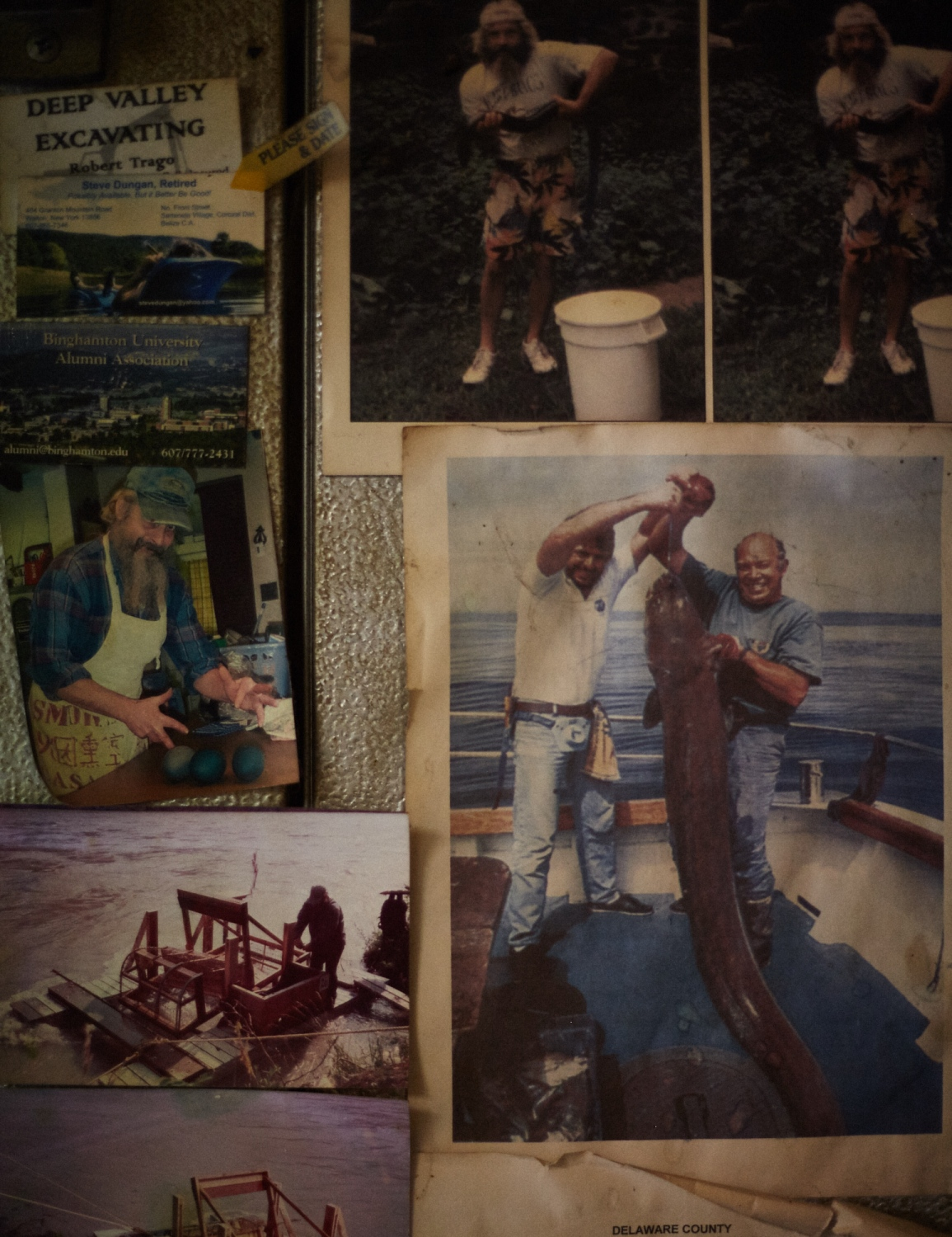 Photographs displaying Eel Ray over the years building his weir, cooking, and fishing hang at the entrance of his smoke shop.