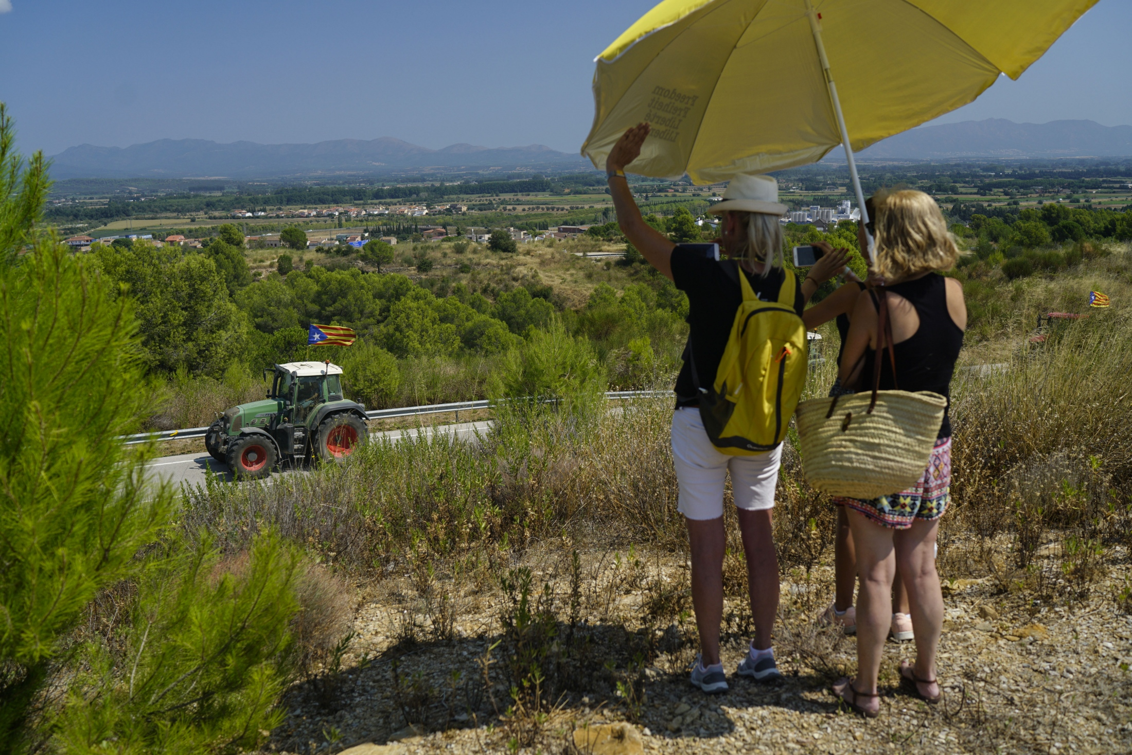 A tractor caravan organized by the Catalan Farmers Union arrives at the Puix de les Basses prison where ex-minister Dolors Bassa is held on charges of Rebellion against the Spanish state for her role in organizing the Catalan independence referendum, August 22nd, 2018.