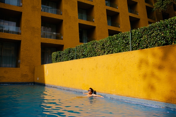 A man relaxes in the swimming pool of the Camino Real hotel in Mexico City, Mexico. (personal work)