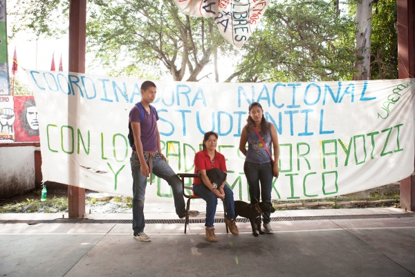 The family of Jorge Antonio Tizapa Legideño - Ivan Tizapa (left), Karolina Tizapa (center), and Hilda Legideño (right), pose for a portrait at the Ayotzinapa Rural Teacher's College on September 3, 2015 in Tixtla de Guerrero, Mexico. Jorge Antonio is a student who disappeared during the Iguala mass kidnapping on September 26, 2014. Photographed for Zeit Magazin.