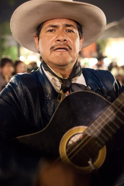 A mariachi plays the guitar in Garibaldi square in Mexico City, Mexico. Photographed for 360 Oslo airport magazine.