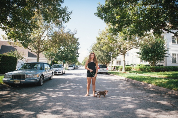 A girl and her dog pose for a portrait in Celebration, Florida. Photographed for Lufthansa Magazine.