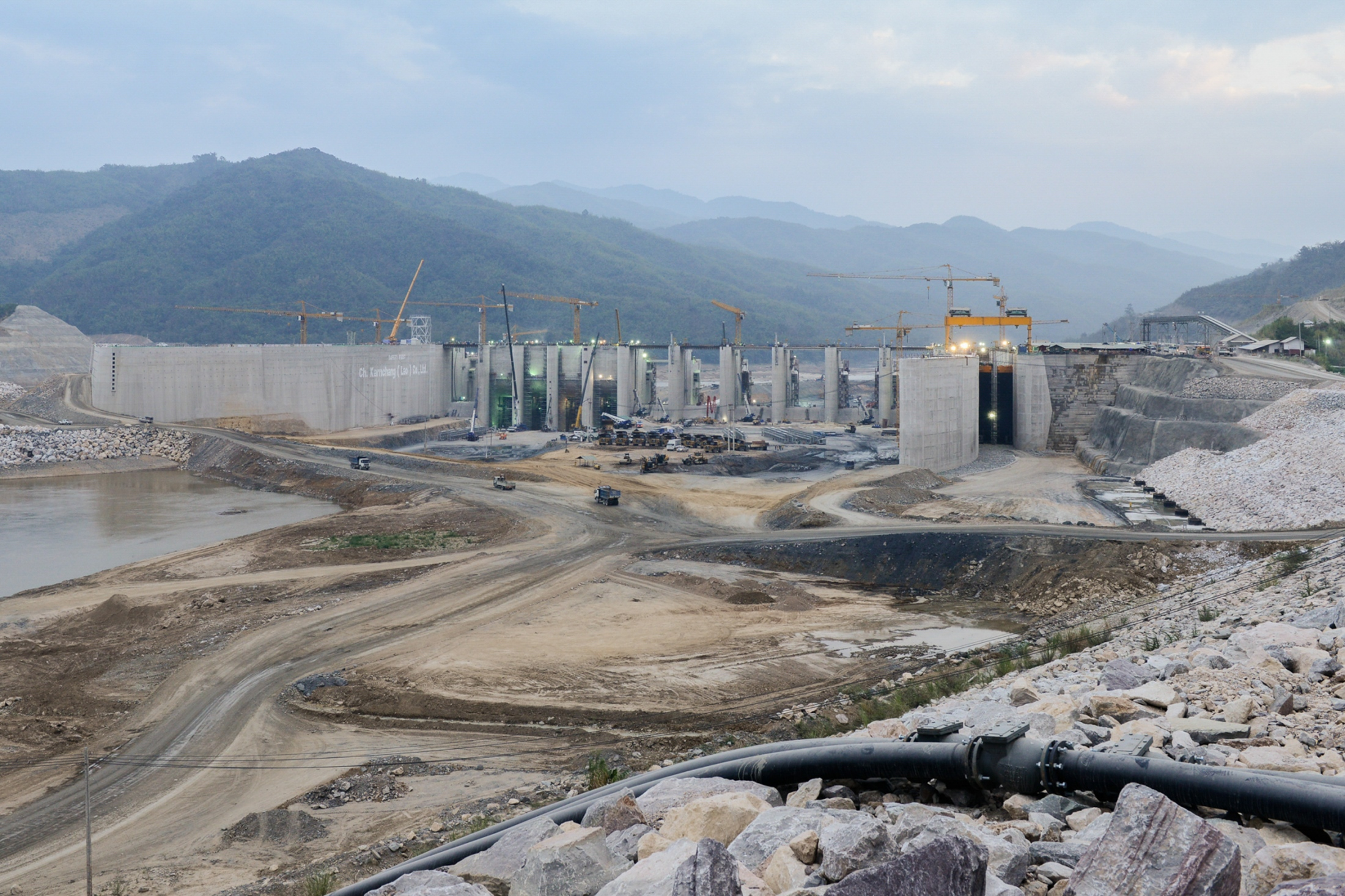 "The Xayaburi Dam would be 820 metres (2,690 ft) long and 32.6 metres (107 ft) high with a rated hydraulic head of 18 metres (59 ft) becomes the largest energy exporter in the region, or the ""Battery of Asia."" Laos is one of the poorest and least developed countries in East Asia. The construction of this massive hydropower dam will expand the electricity capacity for the country and sell it to countries nearby and make huge economic benefits. Critics say it could threaten fisheries and rice cultivation which in turn could also threaten the livelihoods of millions of people living in the lower parts of the Mekong river."